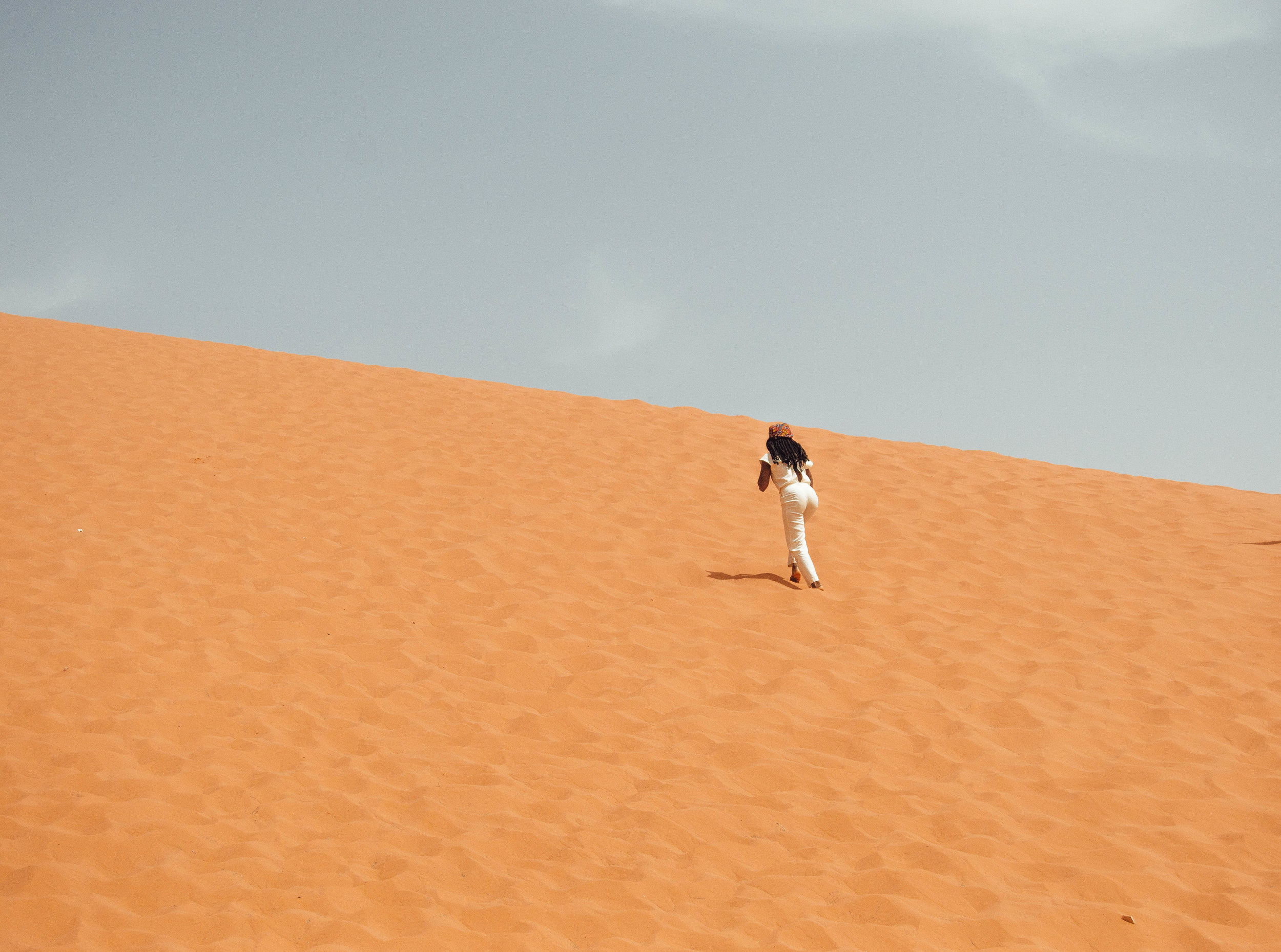 Running up the sand dune is not as easy and it looks.