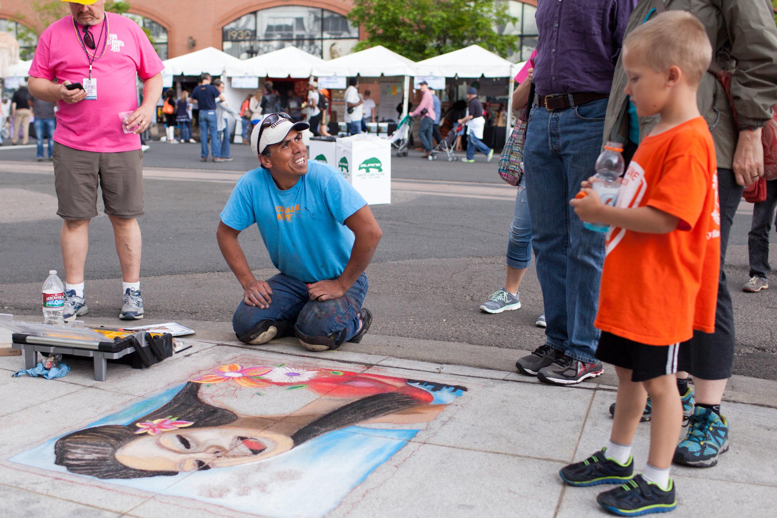 Jazz_Festival_chalk_artist_and_spectators.jpg