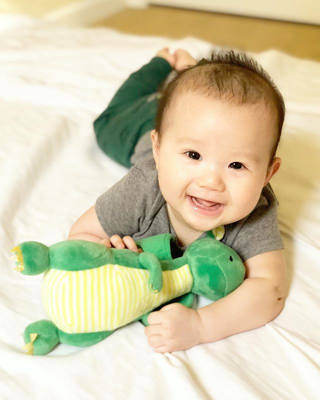 This crazy boy would rather stick out his tongue and make dinosaur noises instead of sleeping! I can't be mad at that big smile!! 😆🦖 #5monthsold #whatissleep