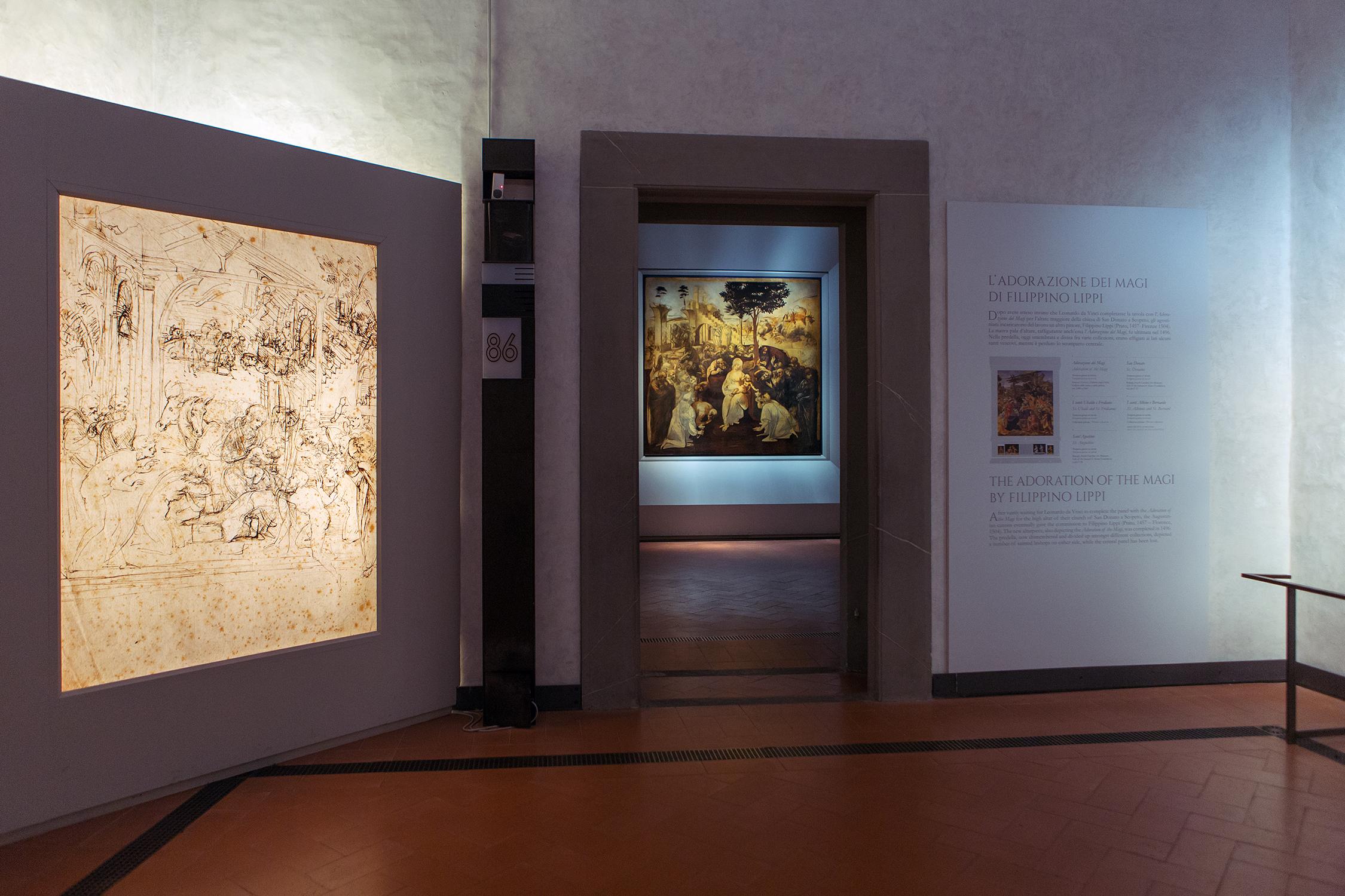 """Galleria degli Uffizi, sale dedicate a Leonardo da Vinci. Al centro, oltre il passaggio, l'opera """"L'Adorazione dei Magi""""."""