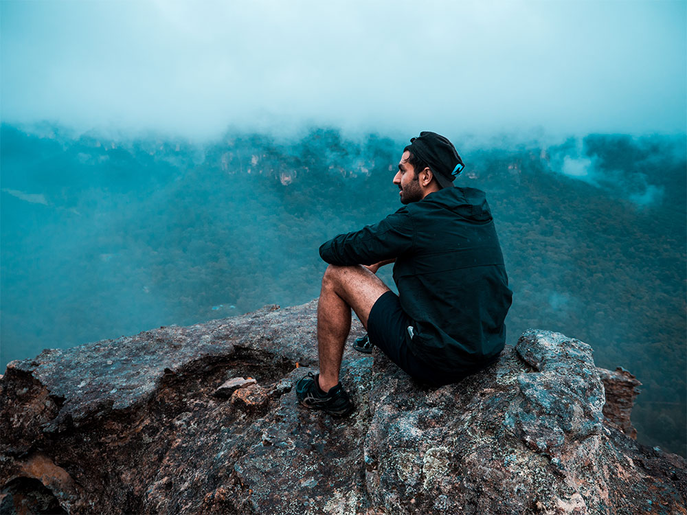Akshay Masters looking at the view after hiking to the top of Mystery Mountain, Newnes, NSW