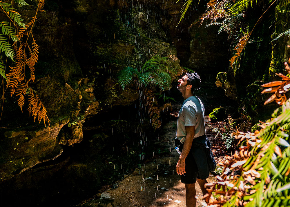 Ash in Dry Canyon looking at a waterfall, Newnes