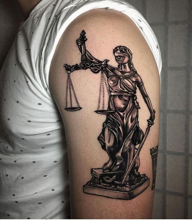 Lady justice by @marktarrozatattoo