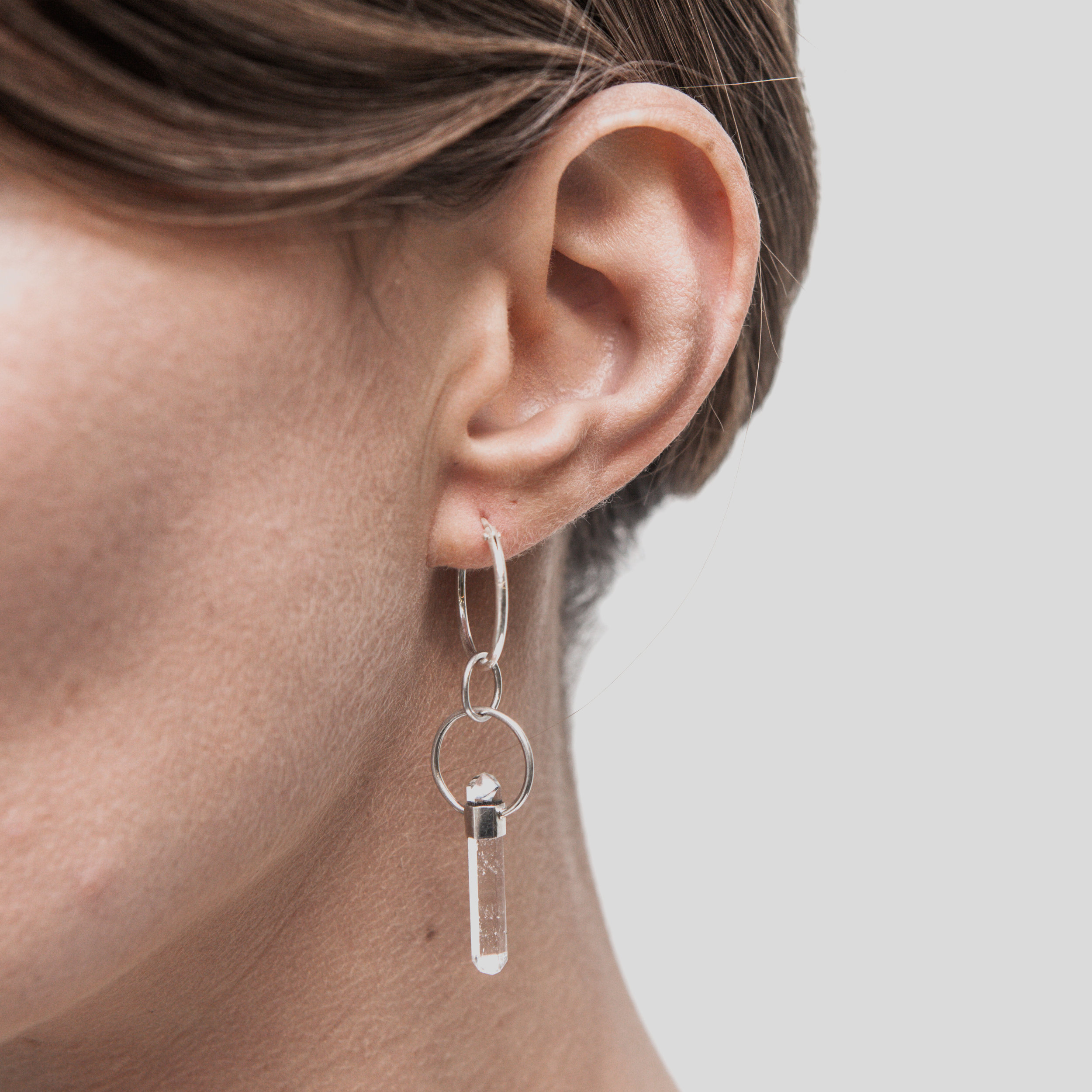 EYESEEI. EXPANSION earring with a roughly cut clear quartz crystal wand set in Sterling silver. Price: 440 SEK Photo: Olle Enqvist