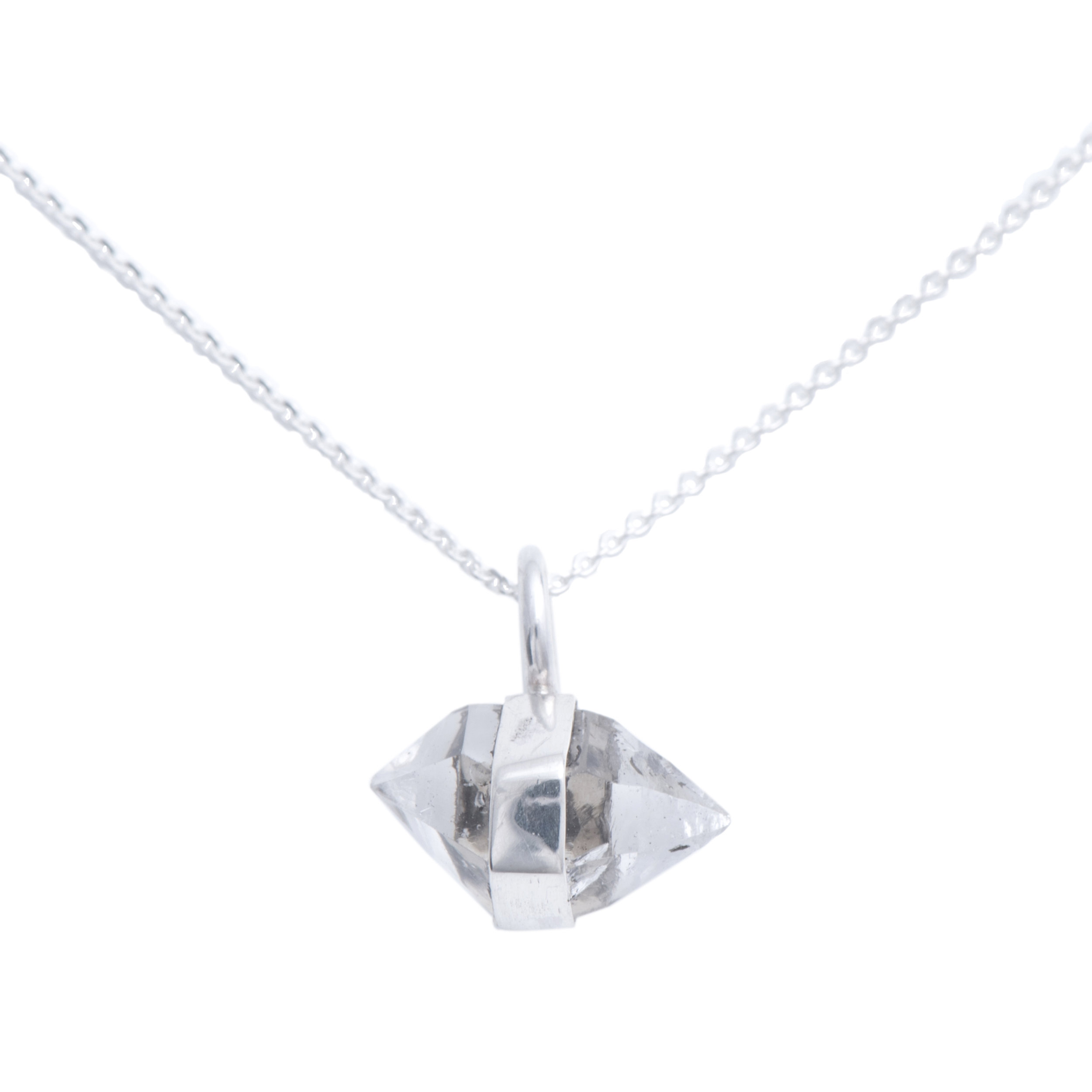 EYESEEi. AAVRE necklace in silver and one raw Herkimer Diamond Crystal. The word means success and happiness in the Southern Sami dialect. Chain length: 43 cm Price: 580 SEK Photo: Naomi Pongolini