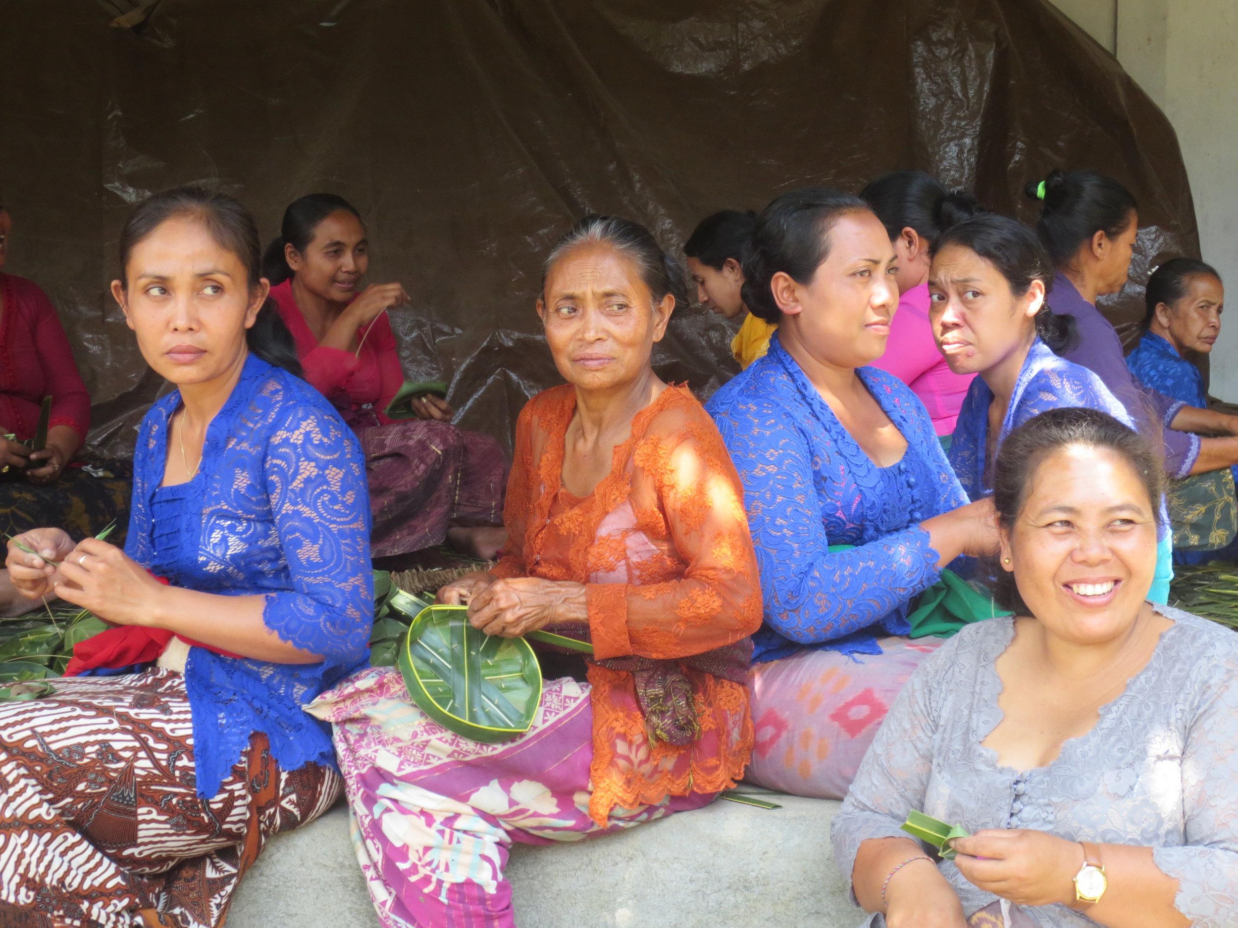 Women preparing offerings