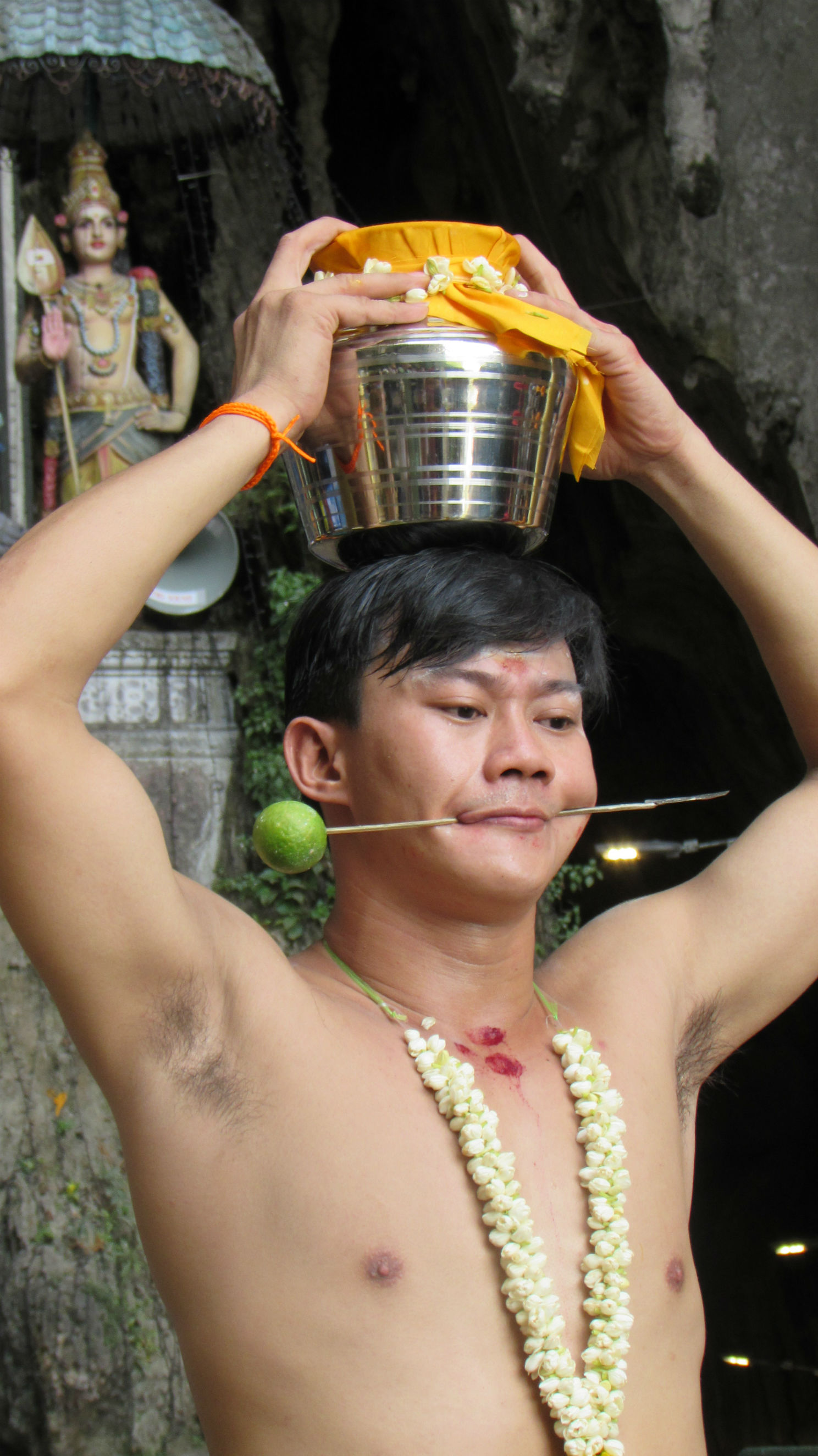 Devotee carrying milk can