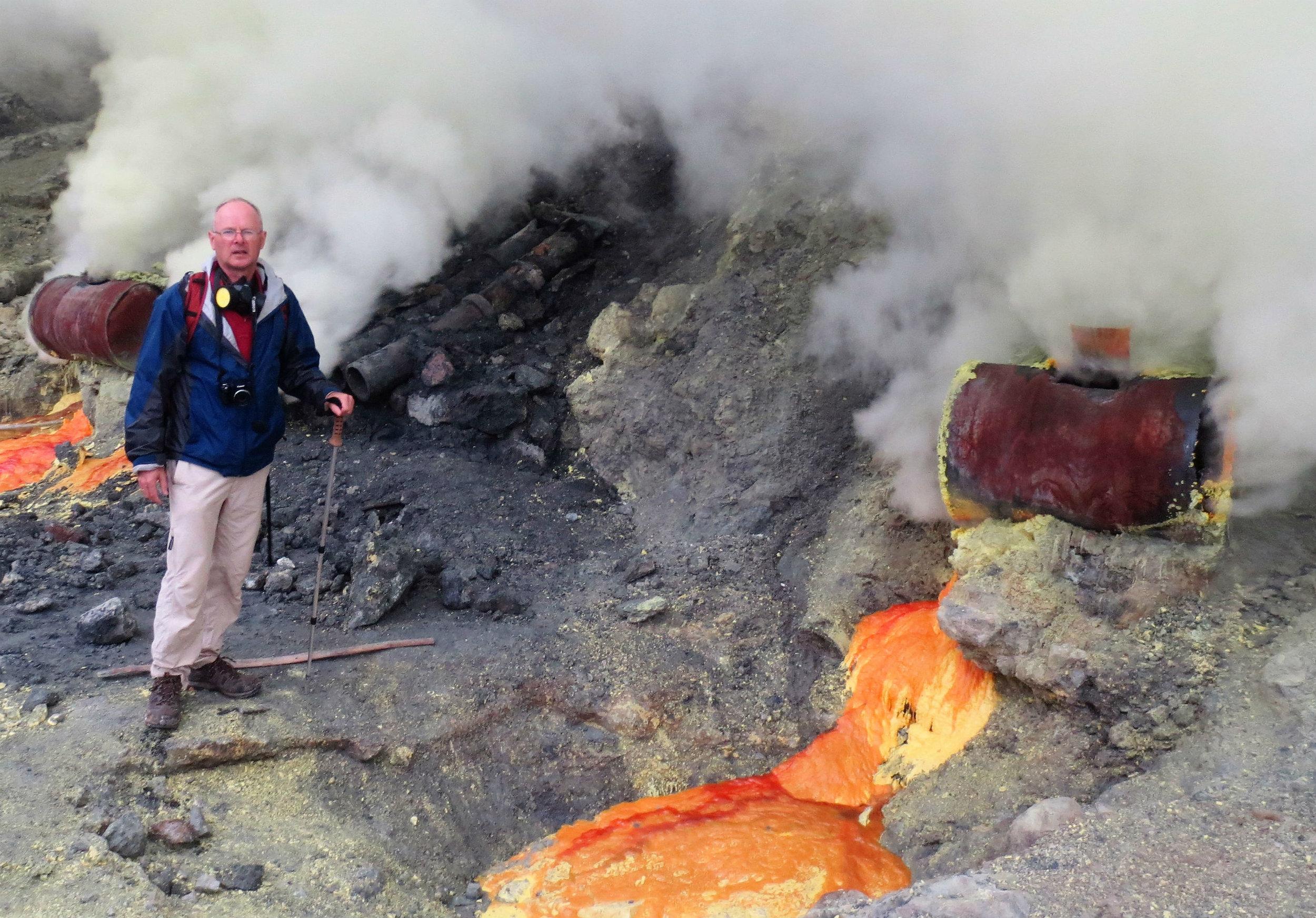 Sulphur mining inside crater - molten sulphur