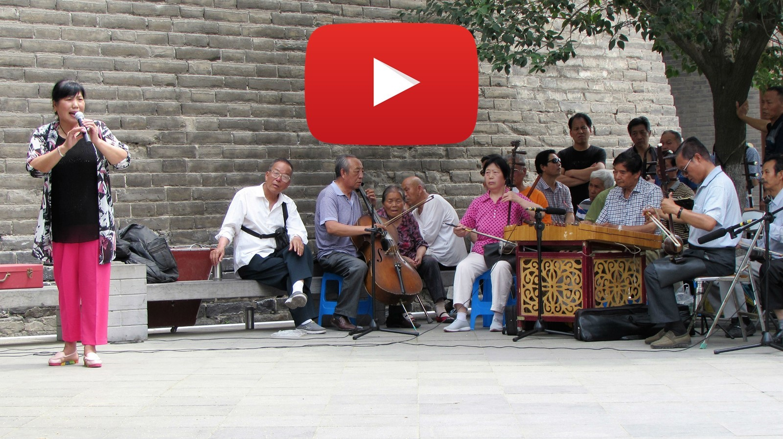 Singing in the park at the foot of the city wall in Xi'an