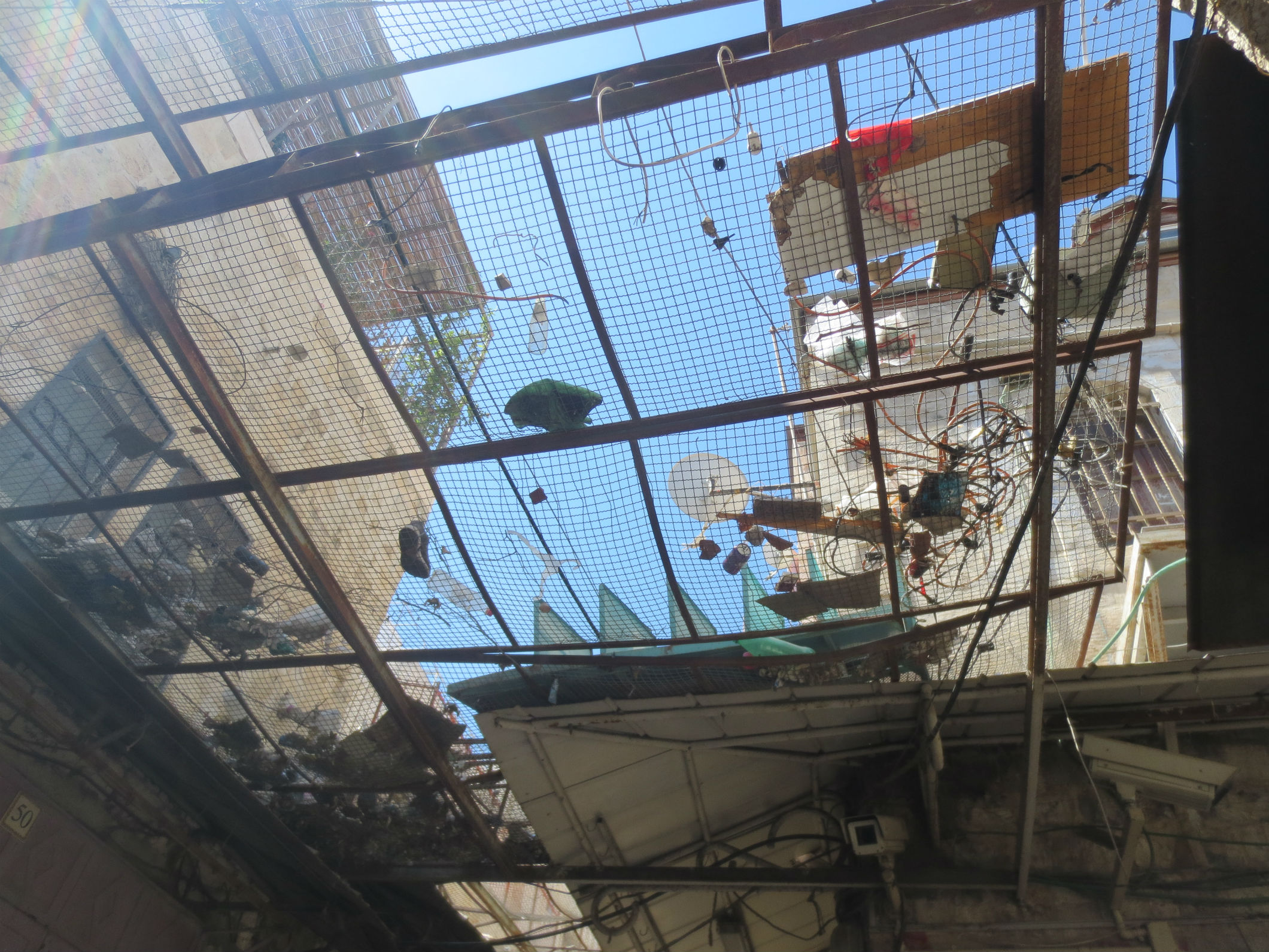 Nets above the narrow alleys in Hebron to prevent trash being thrown on Arab shopkeepers by the Jewish settlers living above.
