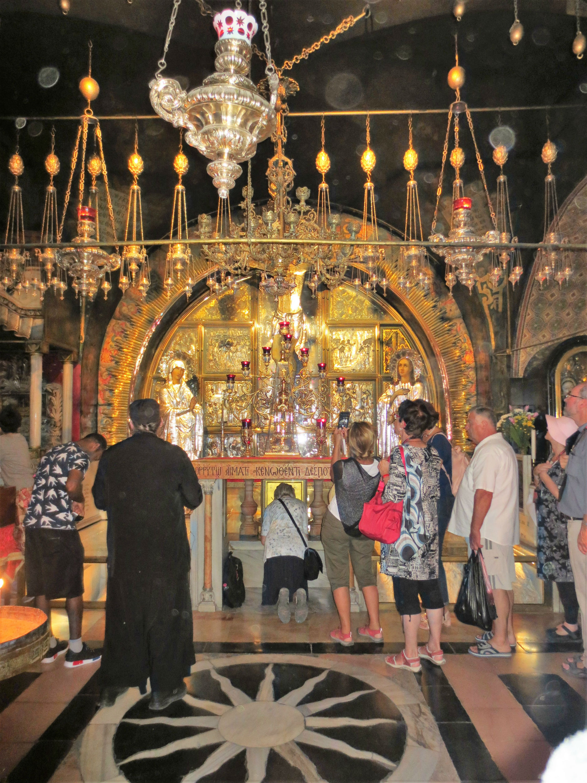 The Church of the Holy Sepulchre where Jesus died and resurrected. Pilgrims kiss the rock on which the cross stood.