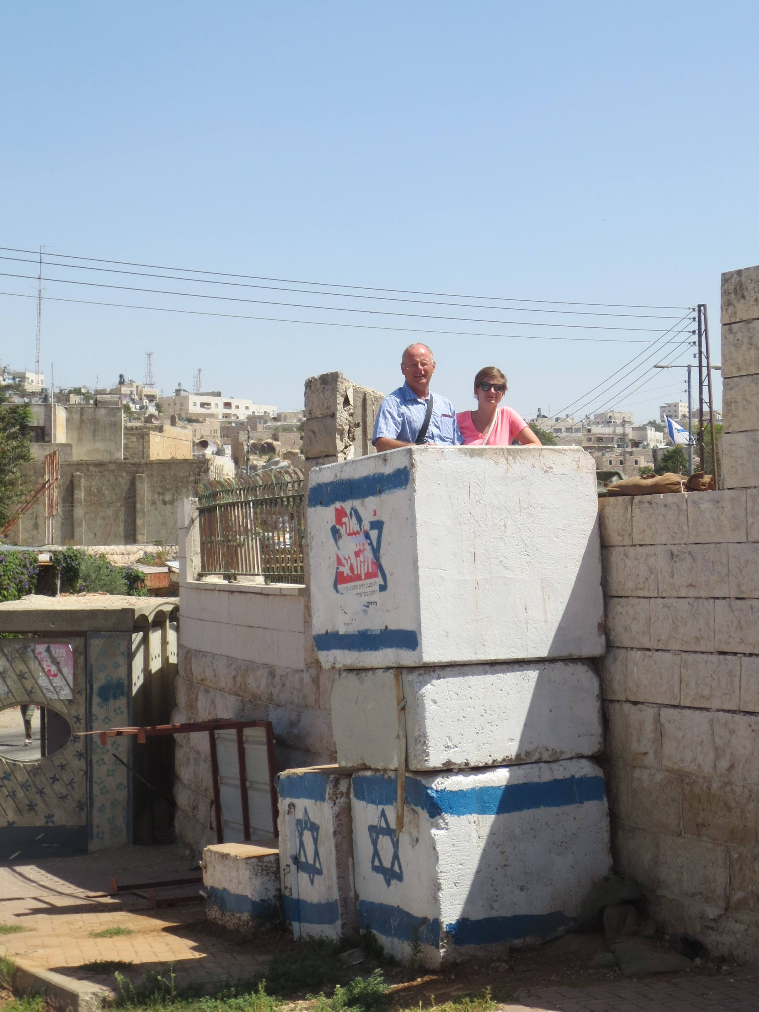 Marcella and Frank at army check point reinforcements, Hebron.