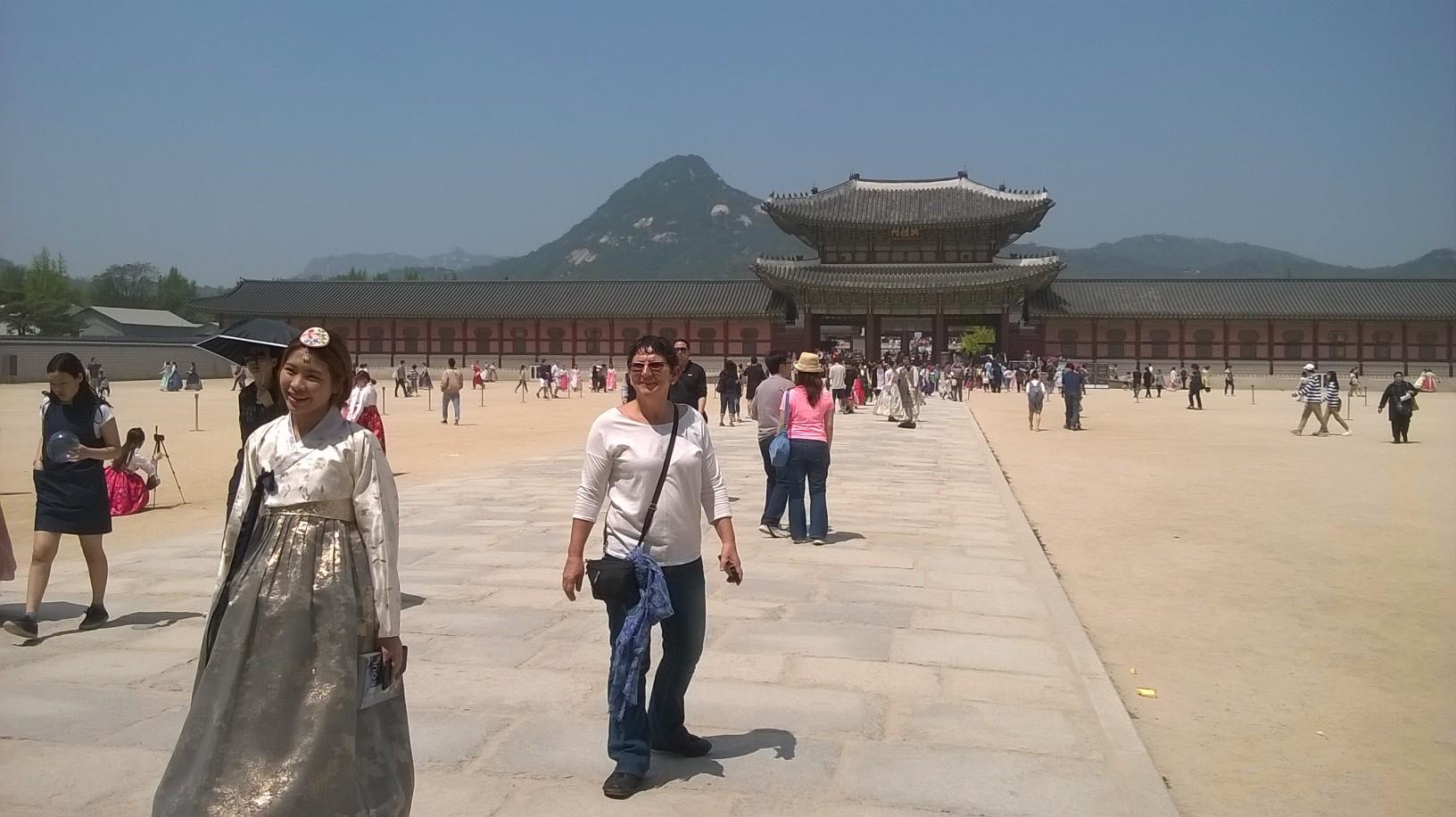 At the Royal Gyeongbokgung Palace with local tourist wearing a hanbok