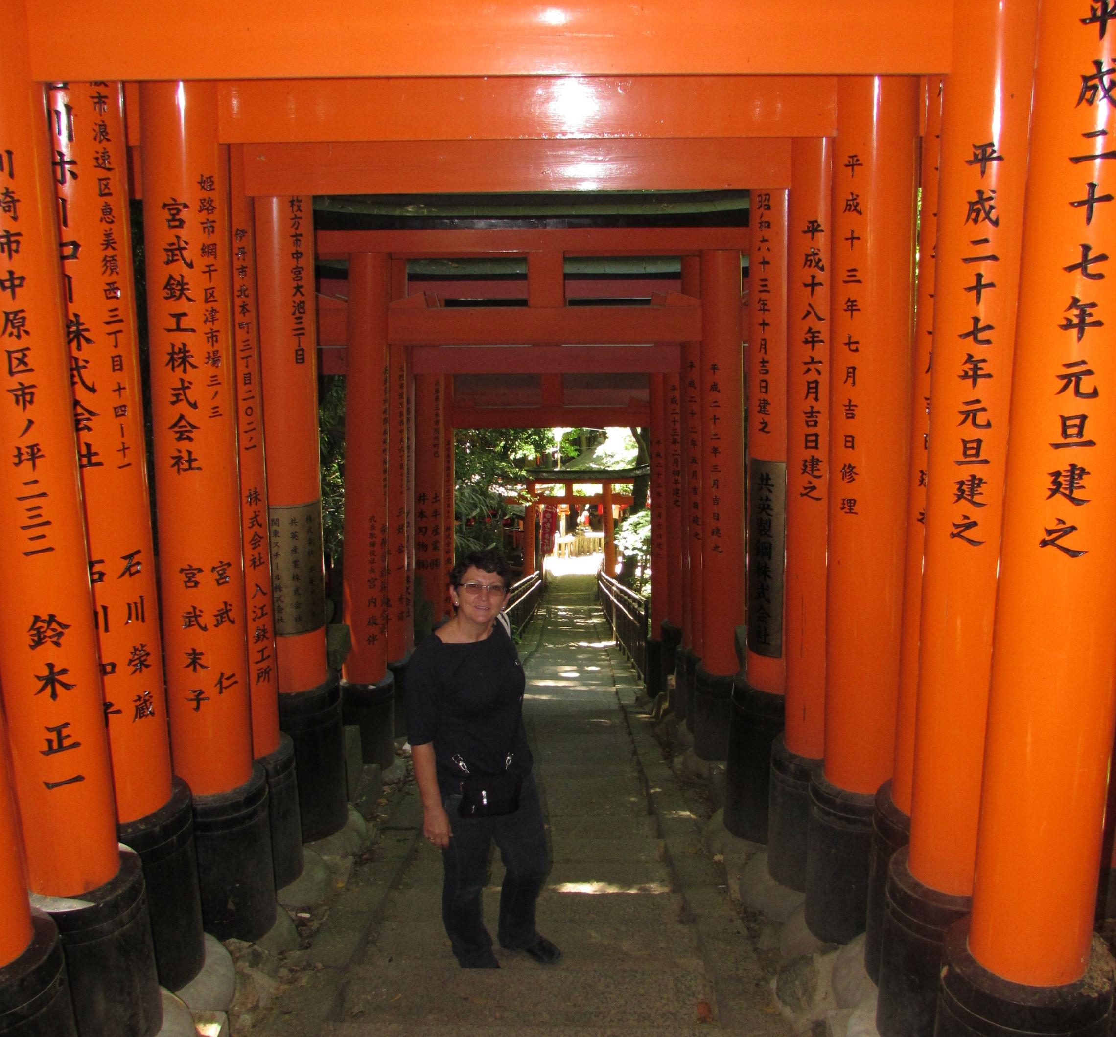 Walking underneath 1000 Torii's of the Fushimishi Inari shrine in Kyoto