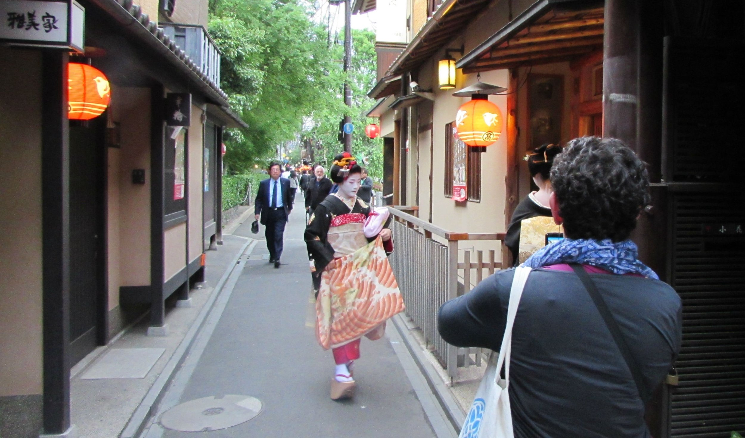 A Geisha in Gion walking to her work