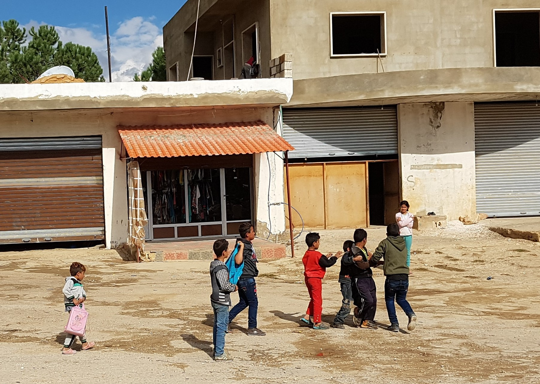 Syrian refugee children playing on the streets