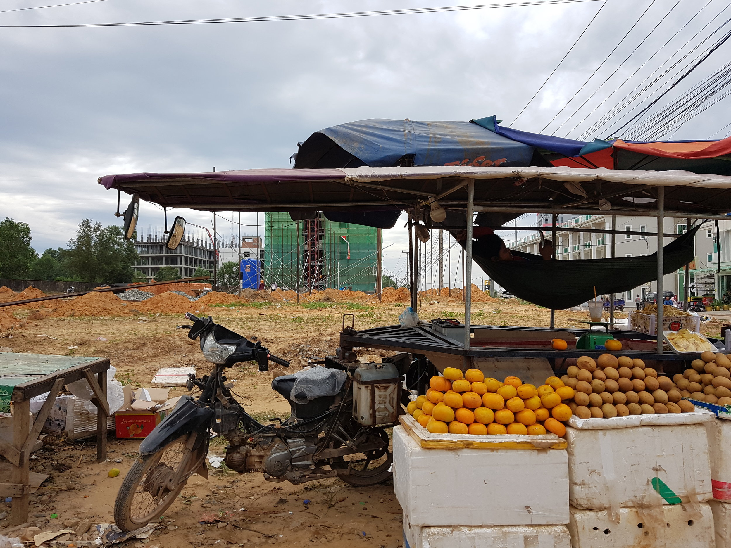 Foodstall in front of building site for new casino