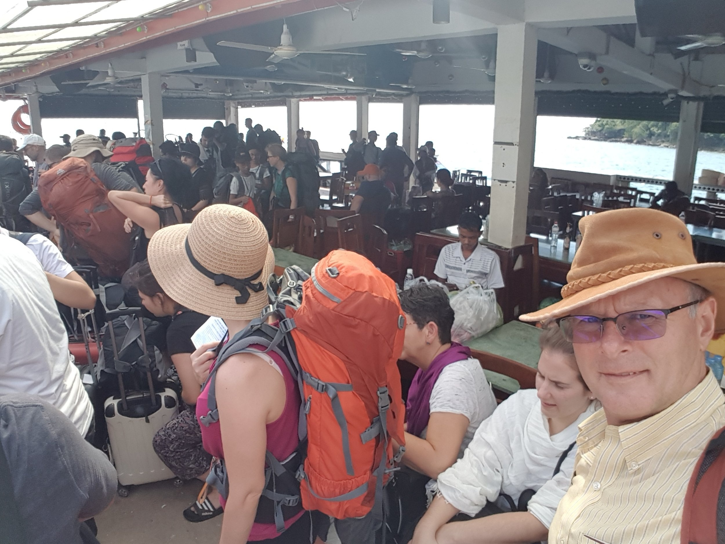 On the Sihanoukville pier trying to get onto the ferry