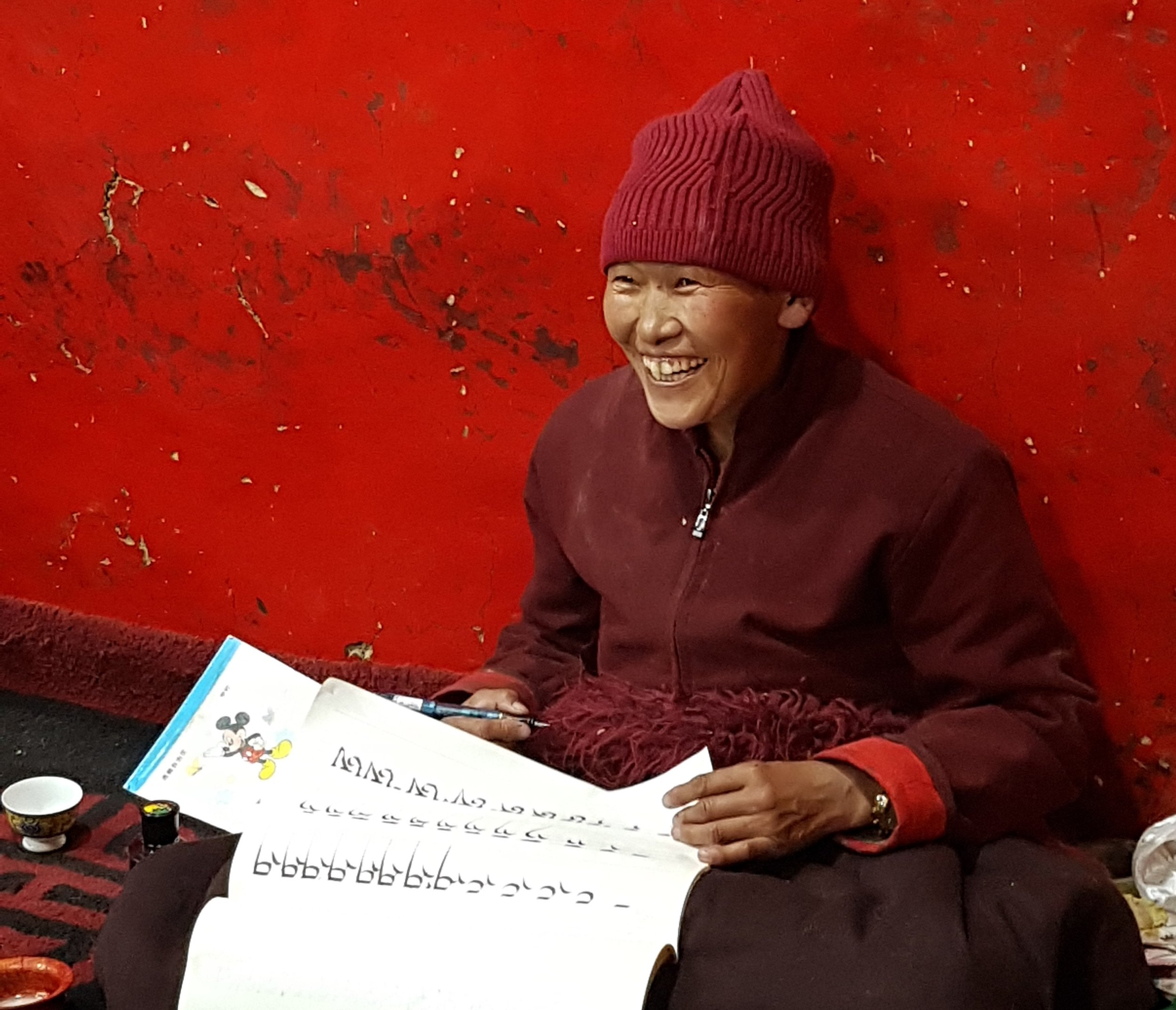 A nun practicing the ancient Tibetan scripture