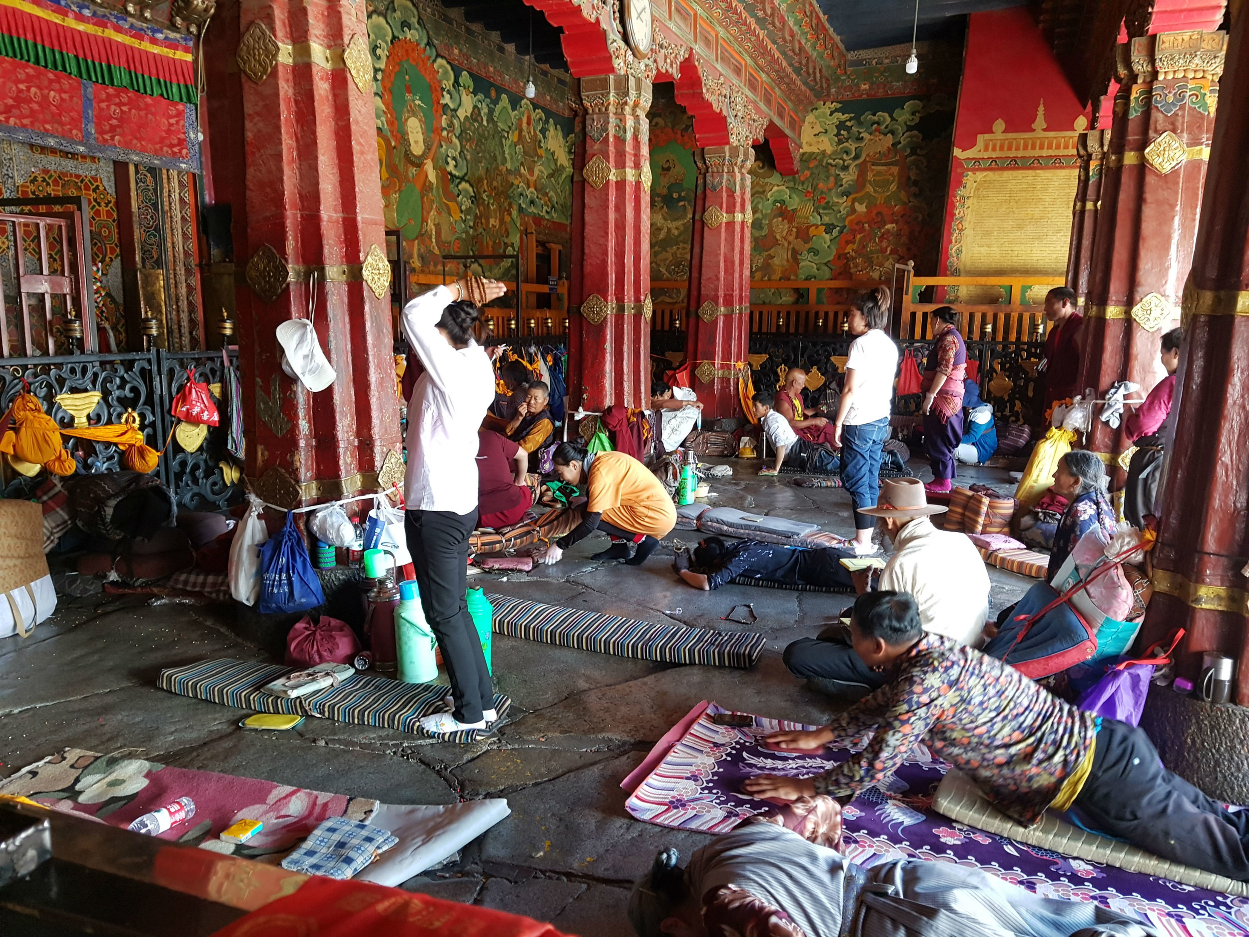 Devotees prostrating themselves in front of Jokhang Temple