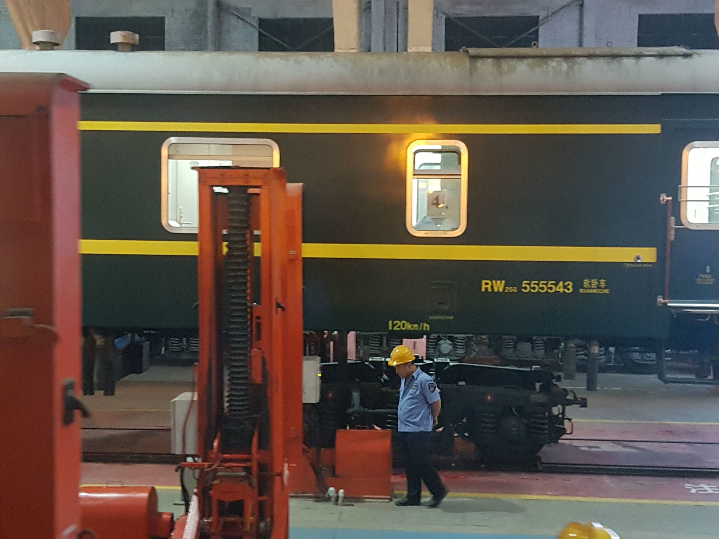 Lifting the train carriage to change its wheels at the Chinese - Mongolian border