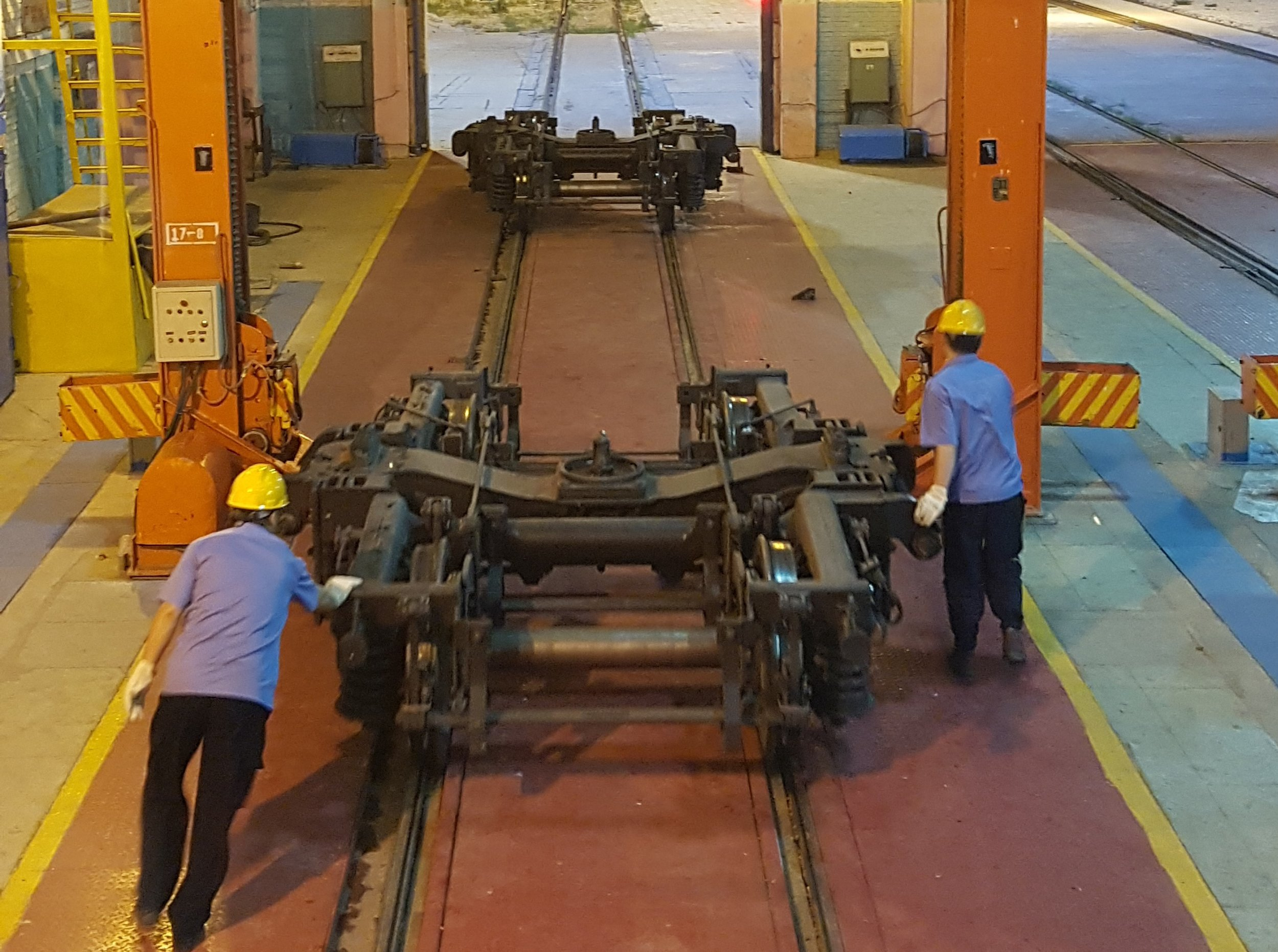 Changing the wheels underneath the train carriages