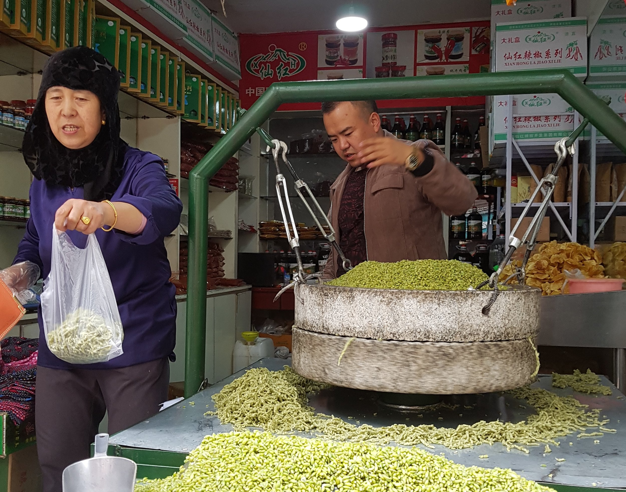 Selling grains in Xining - note typical black scarf of Hui woman