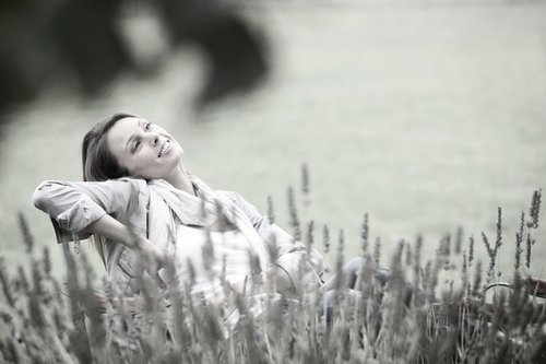 Lady smiling and relaxing in the park after initial orthodontic consultation