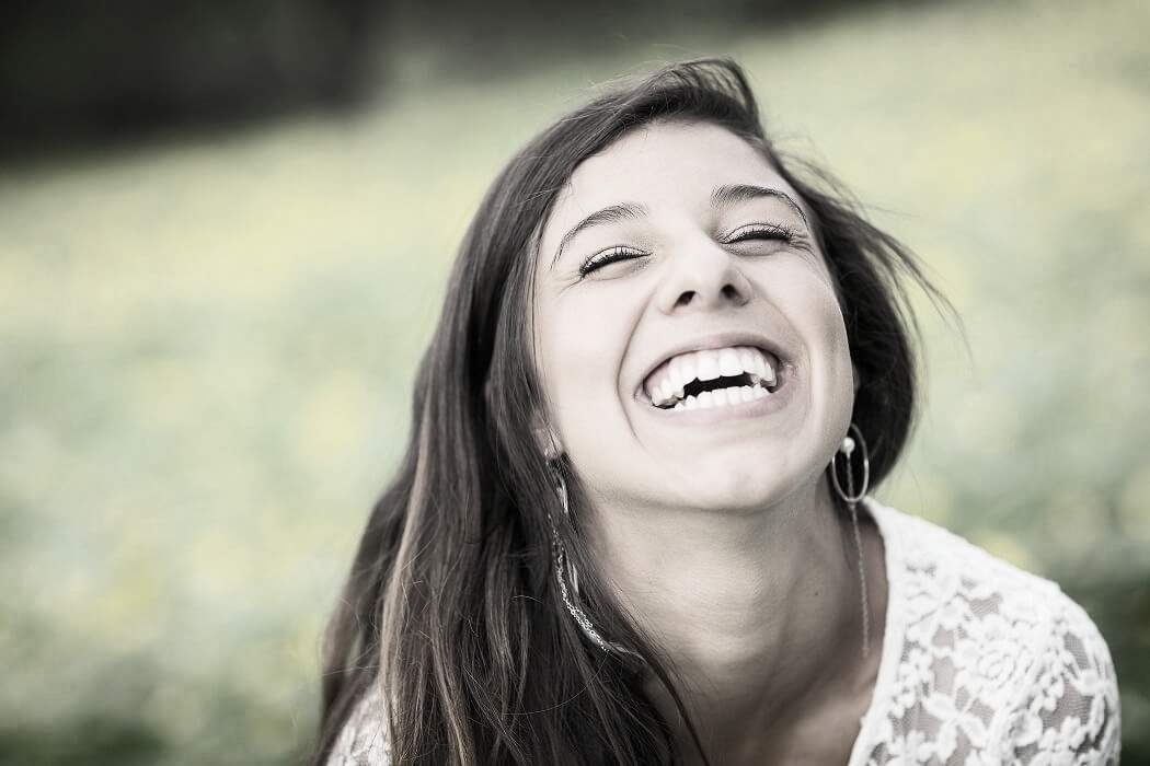 Young lady with big smile following affordable dental treatment in Somerset