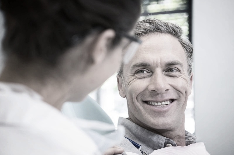 Attractive older man smiling at his dental examination