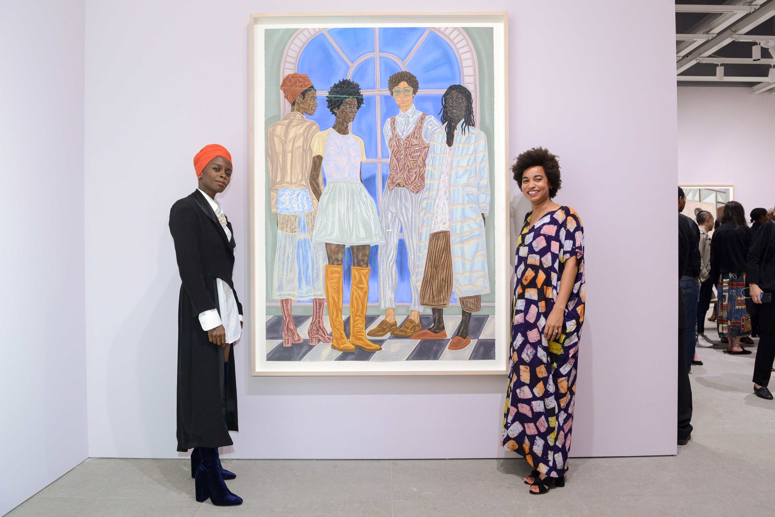 Artist Toyin Ojih Odutola (left) and Curator Rujeko Hockley (right), To Wander Determined  exhibition.Photography by © MatthewCarasella.com