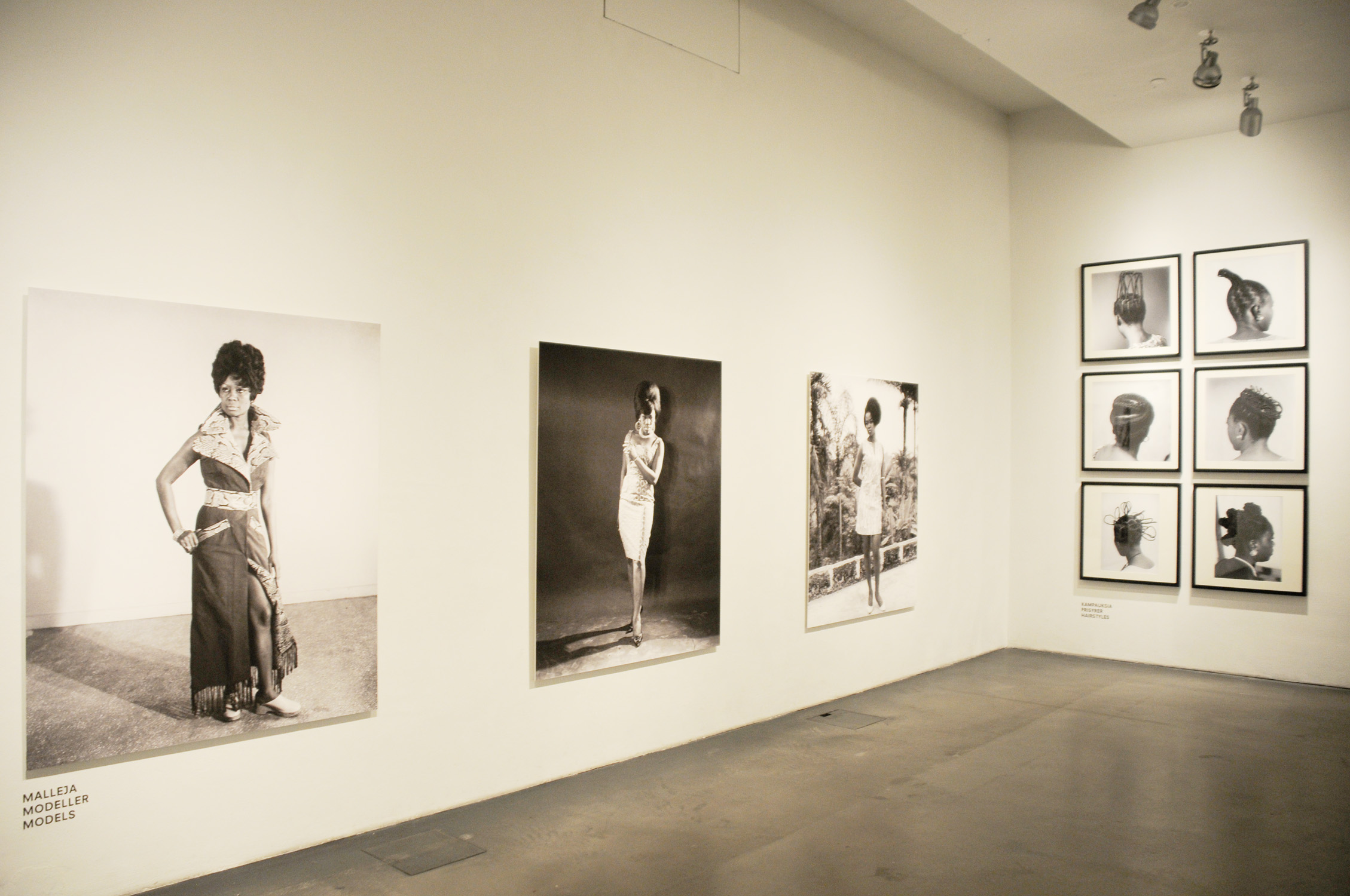 Installation view of  .D Okhai Ojeikere: Moments of Beauty , at Museum of Contemporary Art, Kiasma,2011.  Above:Photo courtesy African Digital Art.