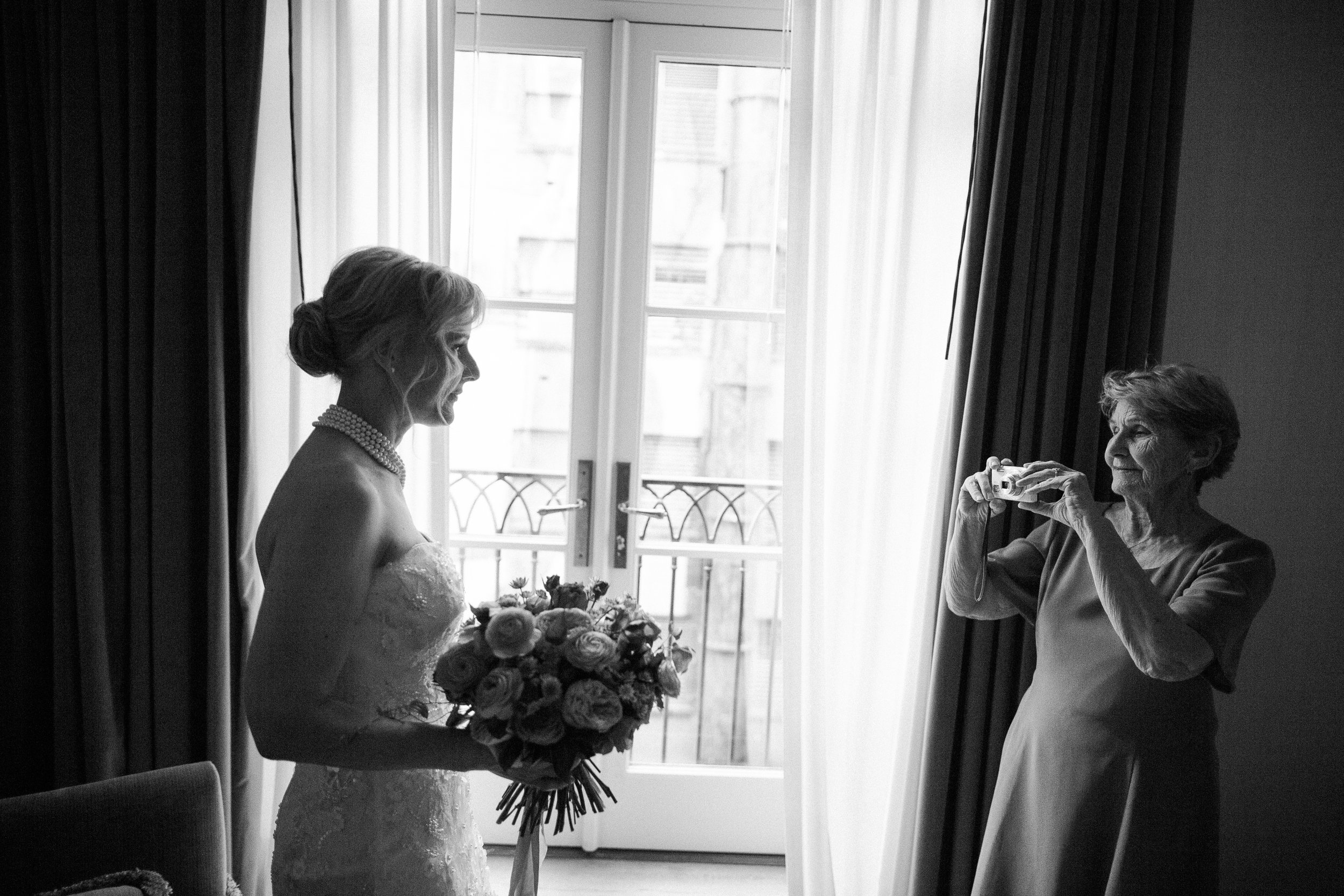 Suzanne's mother takes a moment to capture her daughter, ready to be married.