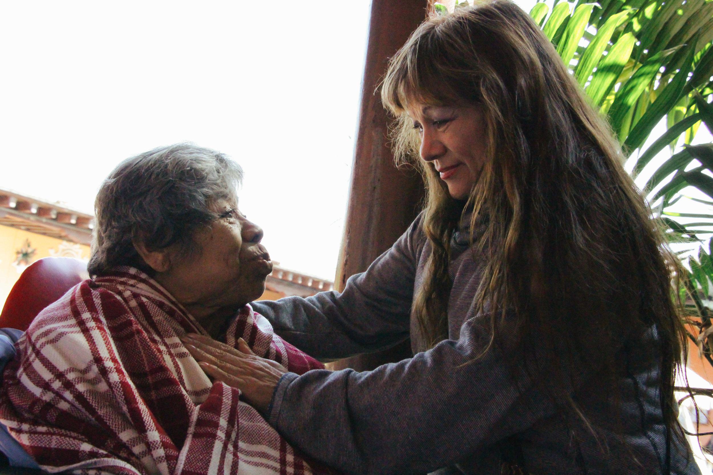 LIDIA ESCOBEDO CHECKS IN ON HER PATIENT MARGARITA PATZAN, 72, AT HOGAR DE ANCIANOS FRAY RODRIGO DE LA CRUZ ON JAN. 17. PATZAN EXPERIENCED INCREASED MOBILITY AFTER RECEIVING PHYSICAL, EMOTIONAL AND SPIRITUAL THERAPY FROM ESCOBEDO.
