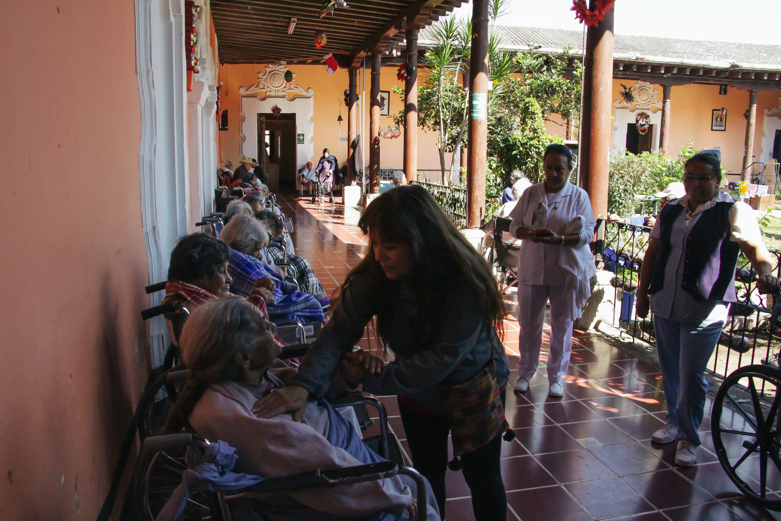 ESCOBEDO CHECKS IN ON HER PATIENT SATURNINA ARRIAGA AT HOGAR DE ANCIANOS ON JAN. 17. ARRIAGA GUESSED SHE WAS 60 YEARS OLD, BUT AFTER CHECKING WITH THE STAFF ESCOBEDO FOUND ARRIAGA TO BE 90 YEARS OLD.