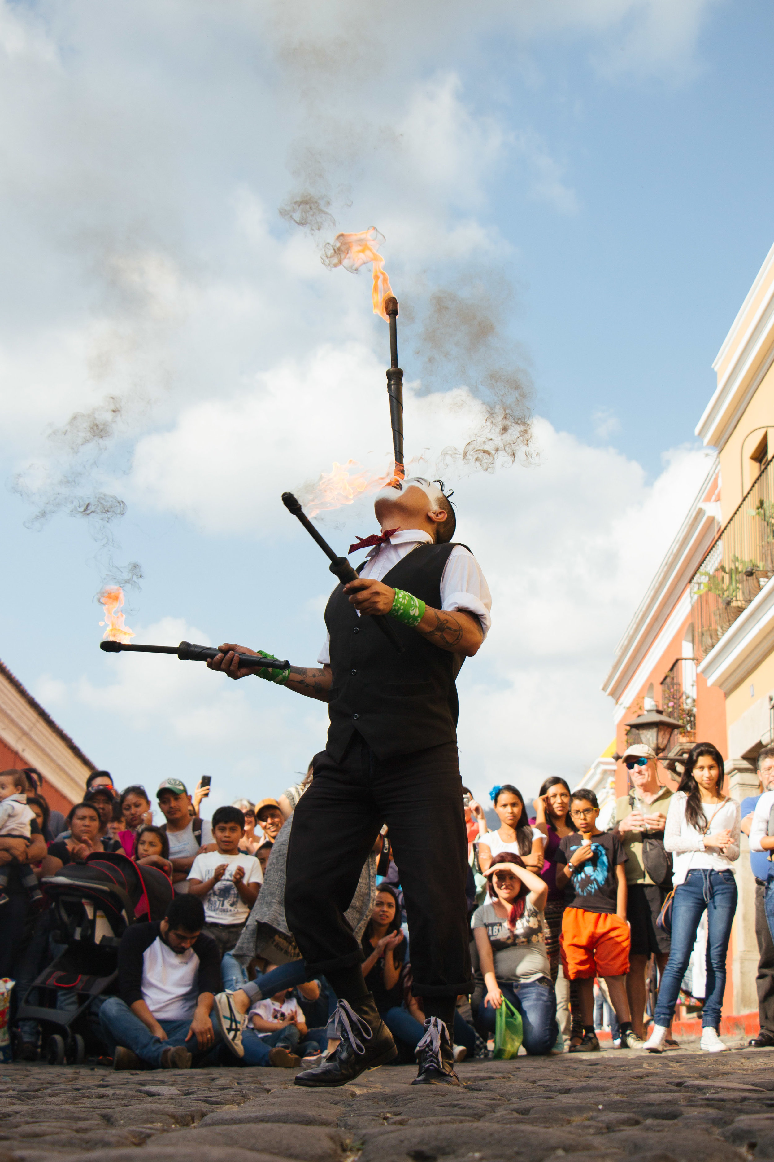 JUAN ESTUARDO TACEN PEREZ BALANCES ONE FIRE TORCH ON HIS FOREHEAD WHILE JUGGLING TWO ADDITIONAL FIRE TORCHES ON 5A AVENIDA NORTE IN ANTIGUA, GUATEMALA JAN. 7. TACEN'S STREET THEATRE PERFORMANCE LASTED ONE HOUR.