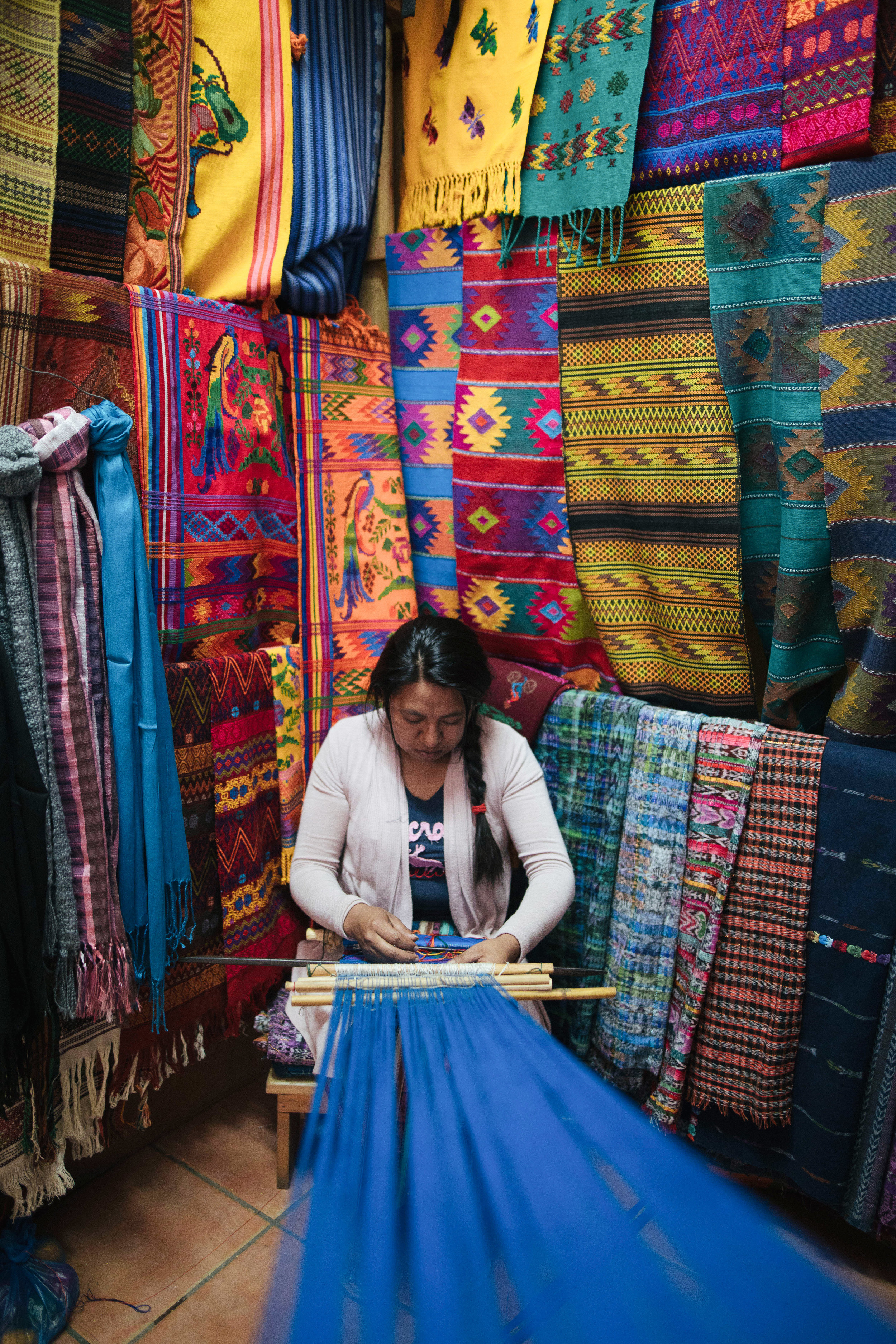 VANESSA MARTINEZ WEAVES USING A BACK-STRAP LOOM IN THE MERCADO DE ARTESANIAS IN SAN ANTONIO AGUAS CALIENTES, GUATEMALA ON JAN. 9. MARTINEZ WOVE HER FIRSTHUIPIL WHEN SHE WAS 7-YEARS-OLD