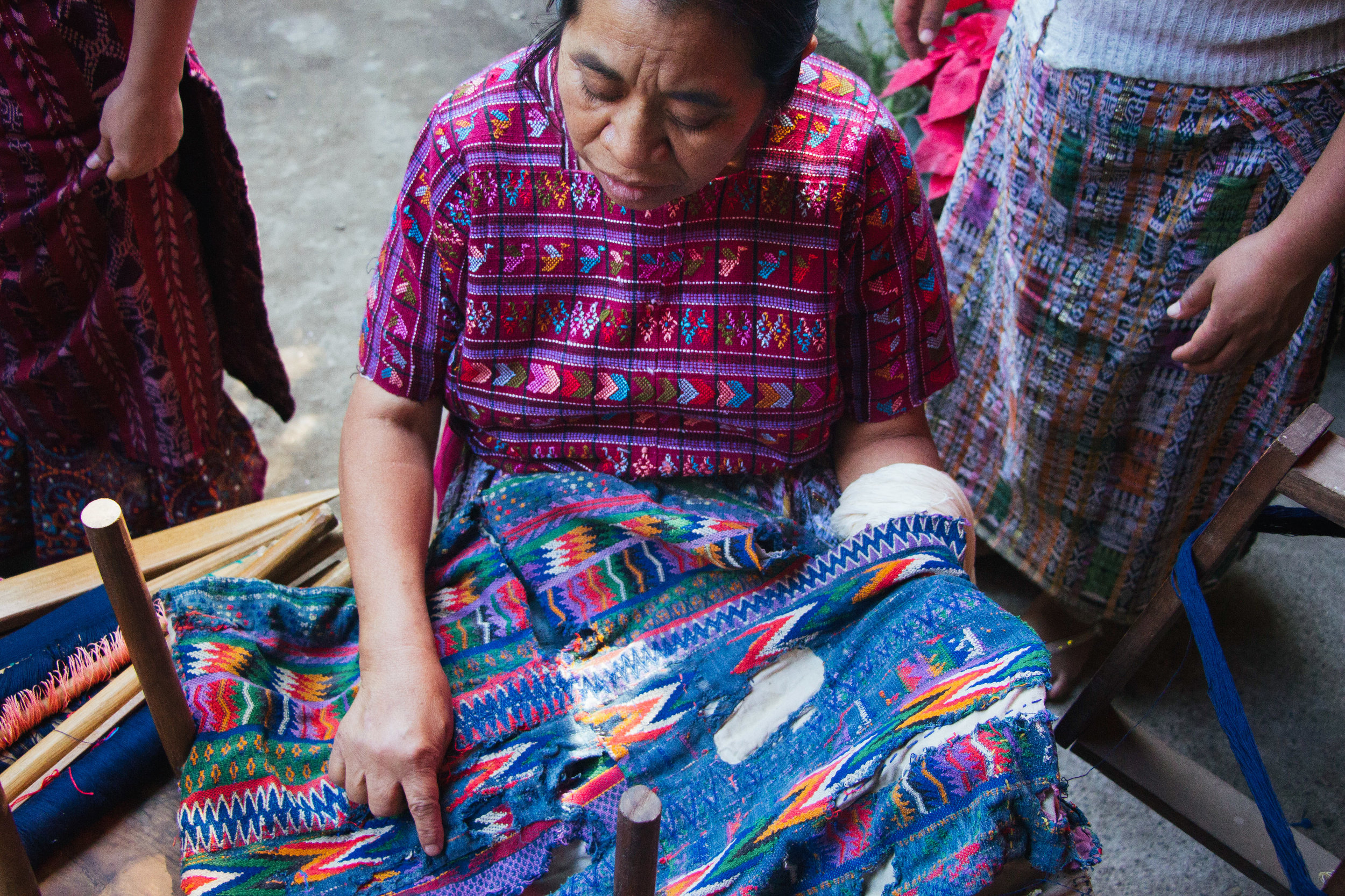 "ELMA LIDIA SOTZ PRESENTS HER GRANDMOTHER'S NEARLY 100 YEAR-OLD HUIPIL IN SAN ANTONIO, GUATEMALA ON JAN. 9. SOTZ TAUGHT HER THREE DAUGHTERS TO WEAVE WHEN THEY WERE CHILDREN.""OUR ANCESTORS TAUGHT US ALL OF THIS,"" SOTZ SAYS"