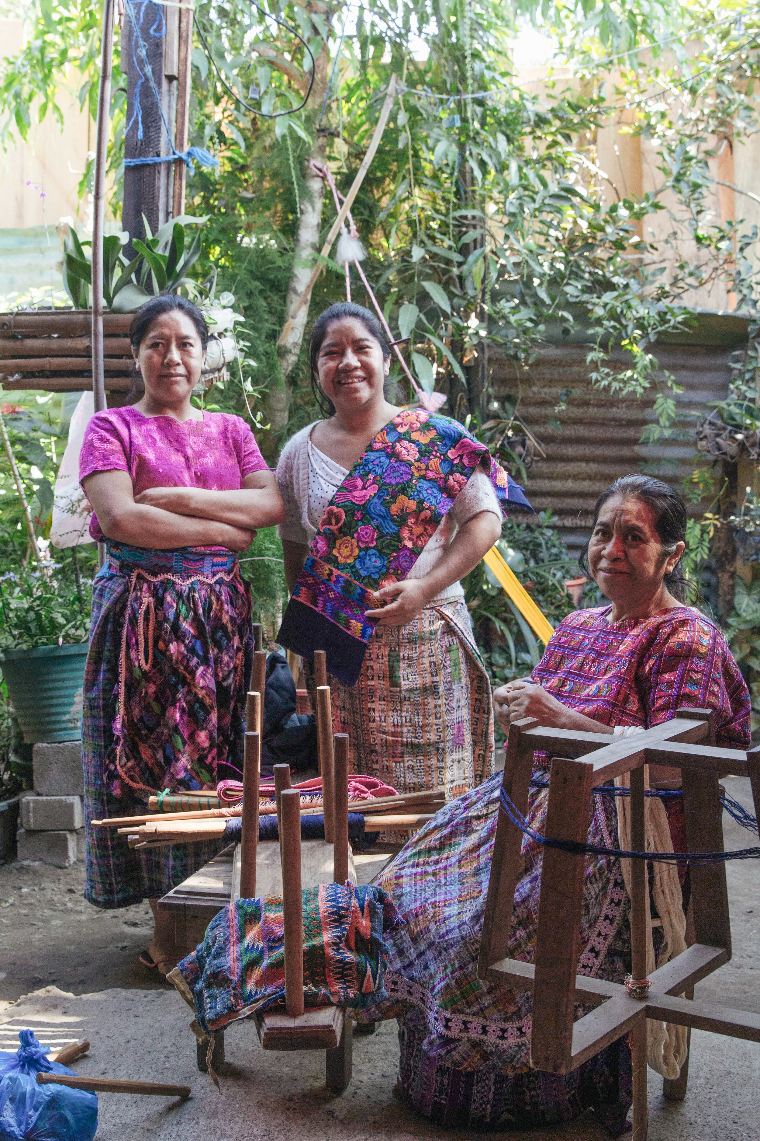 FROM LEFT TO RIGHT, ESMIDA MAIDE MARTINEZ, LADY AMARILIS MARTINEZ, AND ELMA LIDIA SOTZ POSE WITH THEIR HANDMADE TEXTILES AT THEIR HOME IN SAN ANTONIO, GUATEMALA ON JAN. 9. THE WOMEN WORK THREE HOURS EACH MORNING AND THREE HOURS EACH AFTERNOON, WEAVING HUIPILES.