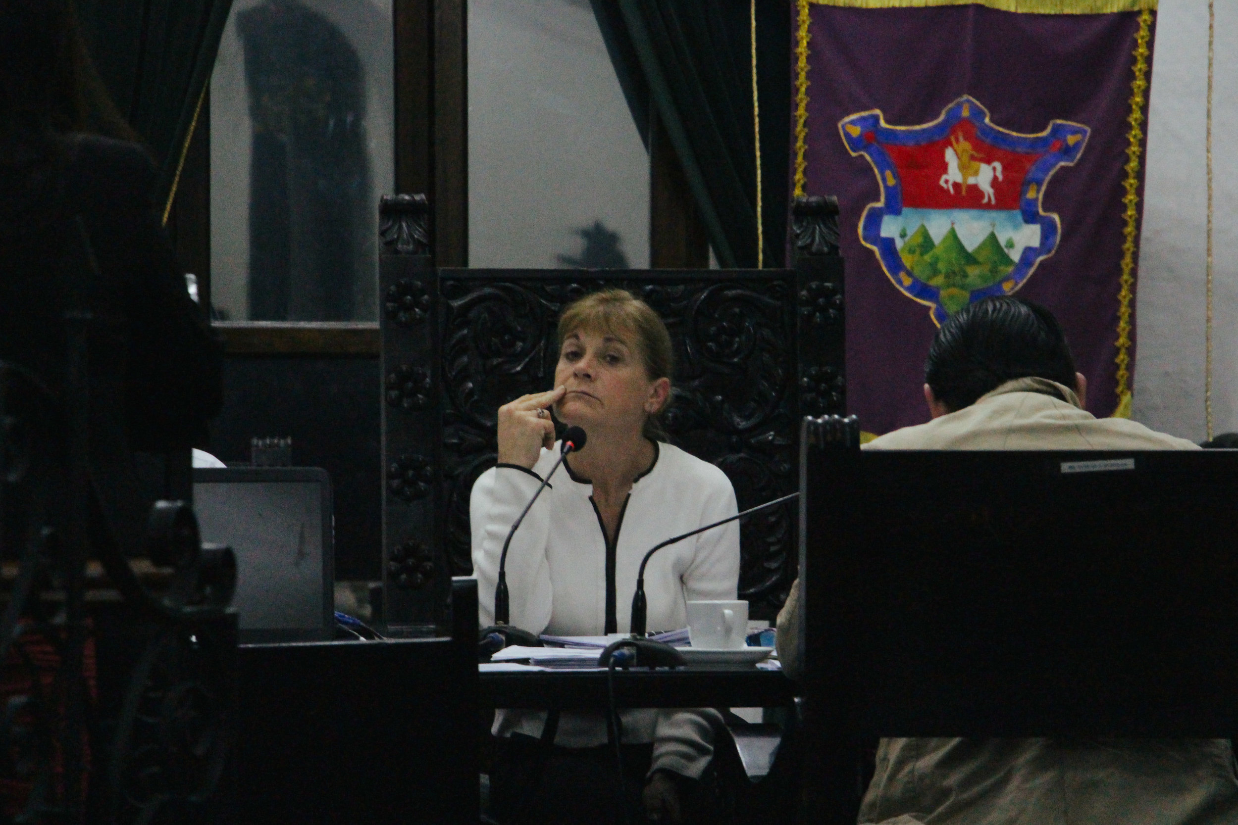 ANTIGUA MAYOR SUSANA ASENSIO RESTS TWO FINGERS BY HER MOUTH AS SHE SITS IN THE CITY COUNCIL MEETING IN CITY HALL ON JAN. 16. ASENSIO, FORMER ARCHITECT, BECAME THE FIRST FEMALE MAYOR OF ANTIGUA ON JAN. 15, 2016 AND WILL HOLD THIS POSITION UNTIL JANUARY 2020.