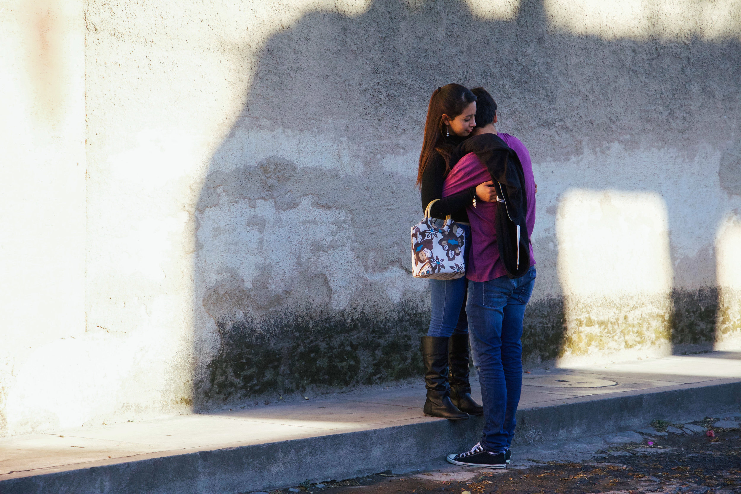 COUPLES EMBRACE AND ROMANCE IN THE STREETS OF ANTIGUA, GUATEMALA THROUGH THE MONTH OF JANUARY. PUBLIC DISPLAYS OF AFFECTION ARE COMMONPLACE IN GUATEMALAN CULTURE