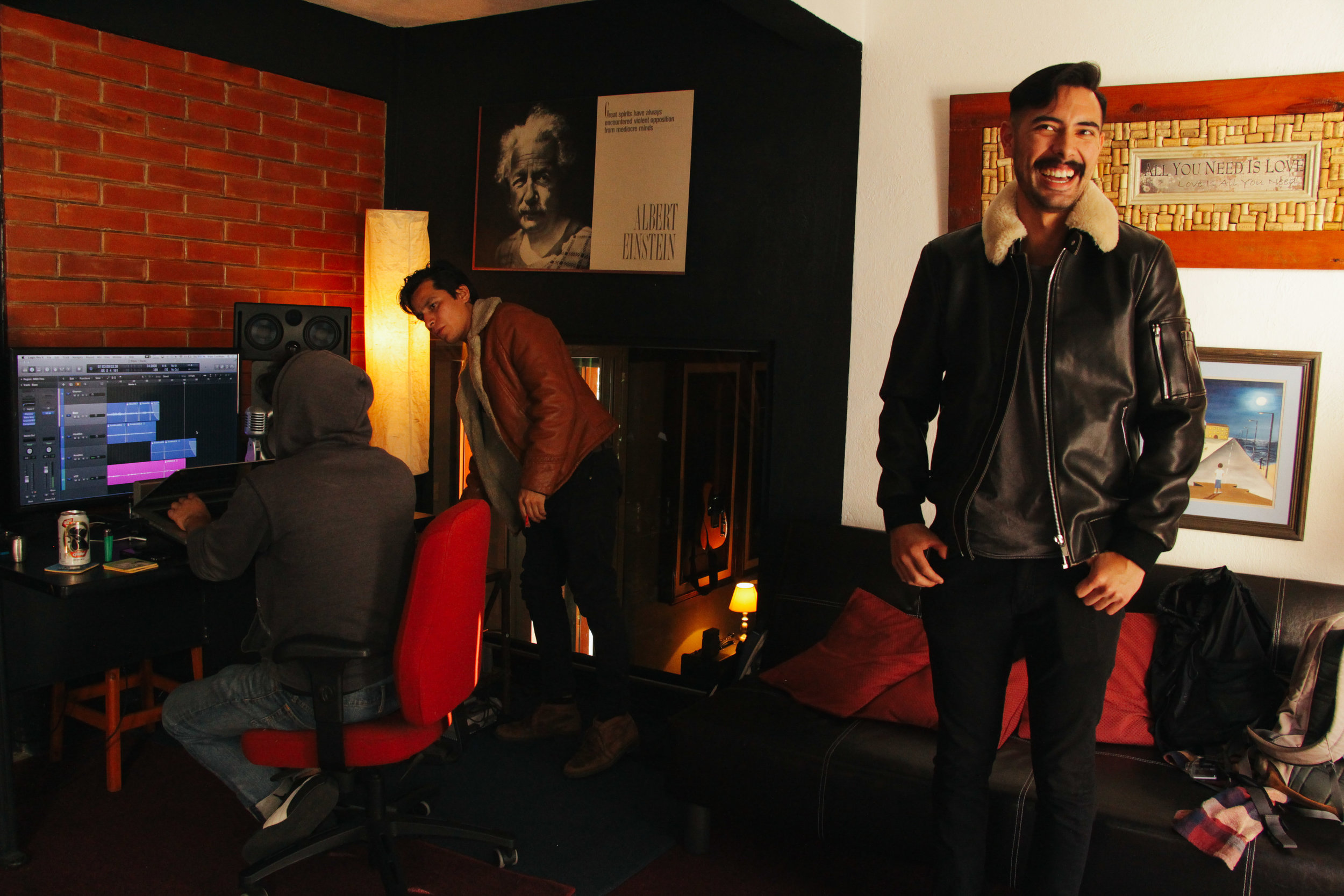 MUSICIAN SEBASTIÁN VILLATORO BENDAÑA CHUCKLES AS HE RECORDS TRACKS FOR HIS RECENT ALBUM WITH PRODUCERS DAVID SUÁREZ AND FRANC CASTILLEJOS AT RECORDING STUDIO ANÁLOGO DIGITAL ON JAN. 12. VILLATORO SINGS IN THE MIGHTY CURRENT, A FOLK AND BLUES BAND BASED OUT OF GUATEMALA CITY.