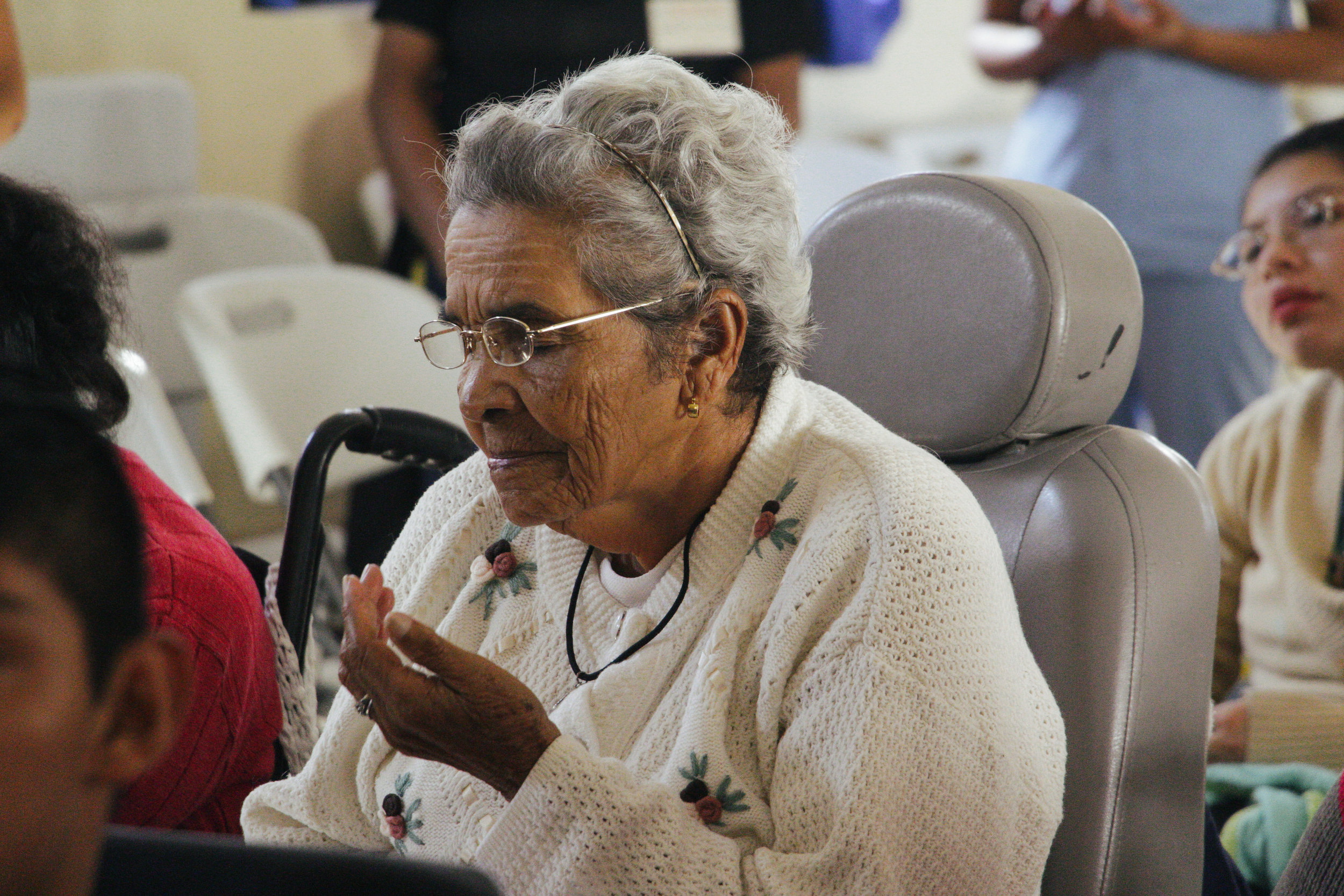Photo by Miranda Weippert MARIA MATILDA, 83, CLOSES HER EYES TO PRAY WHILE PARTICIPATING IN MASS AT VIRGEN DEL SOCCORRO JAN. 19. VIRGEN DEL SOCORRO HOSTS MASS EVERY THURSDAY AND SUNDAY.