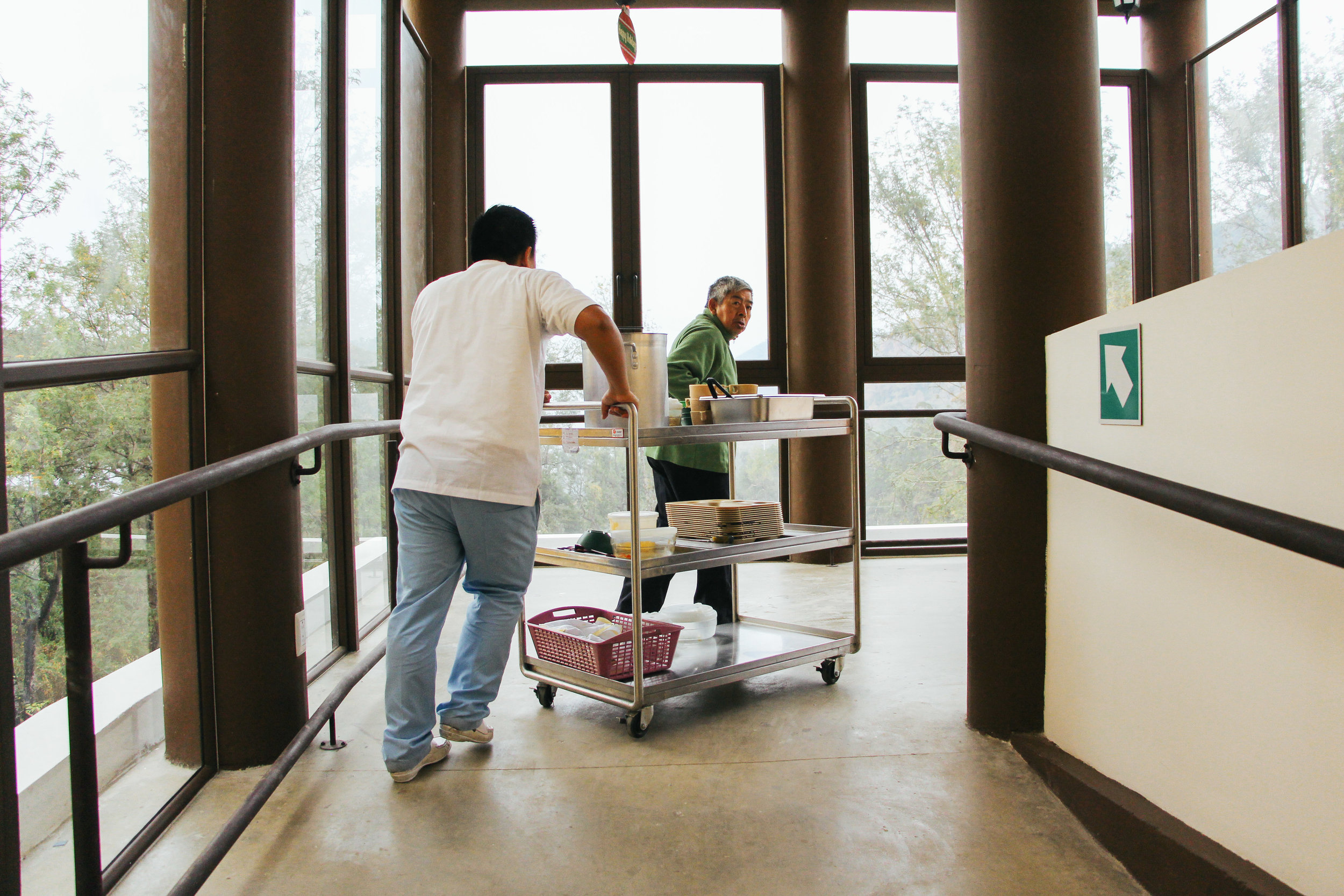 Photo by McKenzie Van Loh CATARINO PEREZ, 63, PULLS A CART OF DISHES FROM THE SECOND FLOOR TO THE KITCHEN AT VIRGEN DEL SOCCORRO JAN. 17. PEREZ OFTEN HELPS THE STAFF AT VIRGEN DEL SOCCORRO MOVE CARTS AND WHEELCHAIRS.