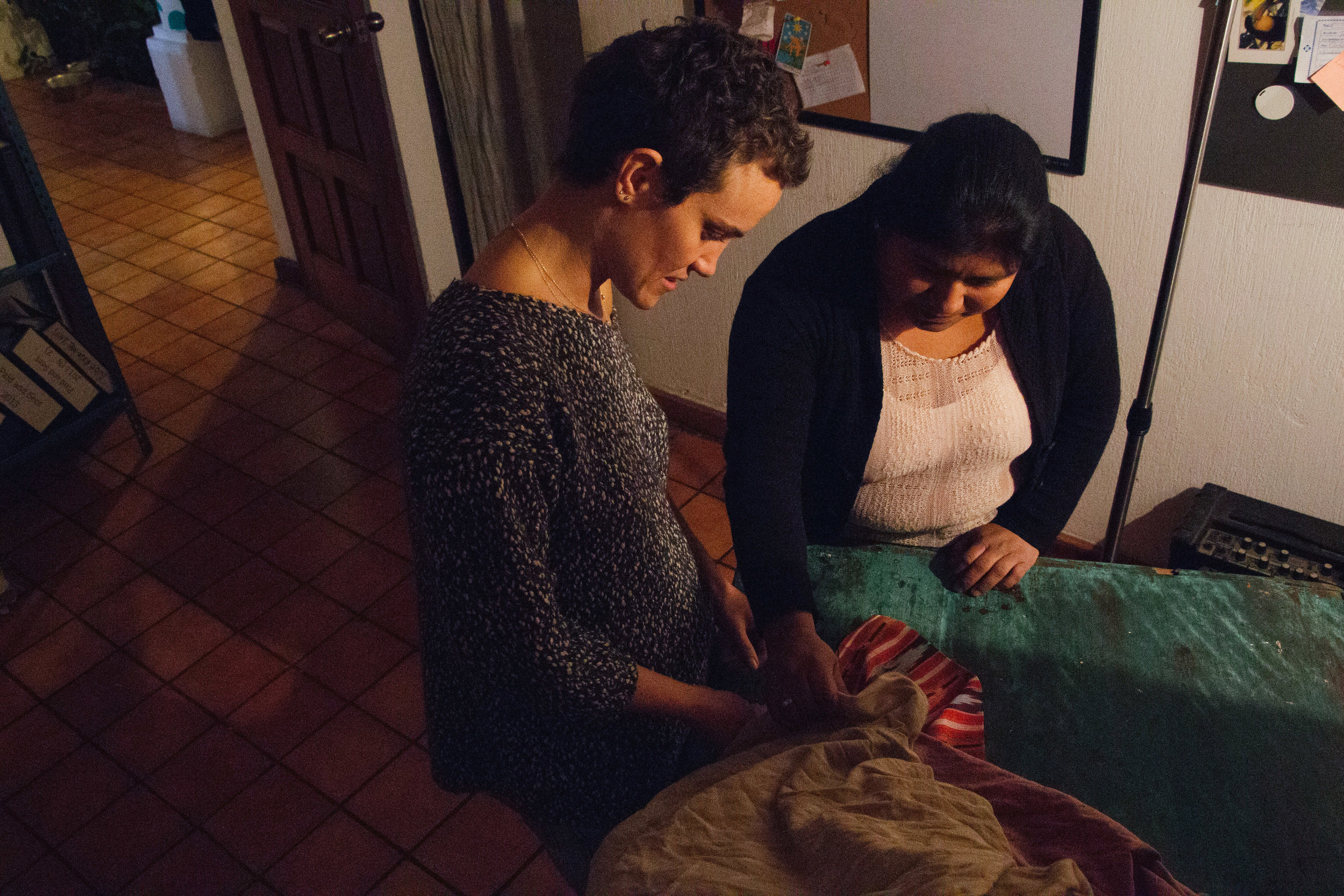 "GÓMEZ AND BERCOVICI COLLABORATE ON AN EVENING WORK SESSION TO GO OVER TEXTILE DESIGNS IN BERCOVICI'S OFFICE AT THE STELA 9 AIRBNB IN ANTIGUA, GUATEMALA ON JAN. 13. ""SHE TELLS ME WHAT EVERYTHING COSTS AND I NEVER FIGHT HER ON IT,"" BERCOVICI SAYS."