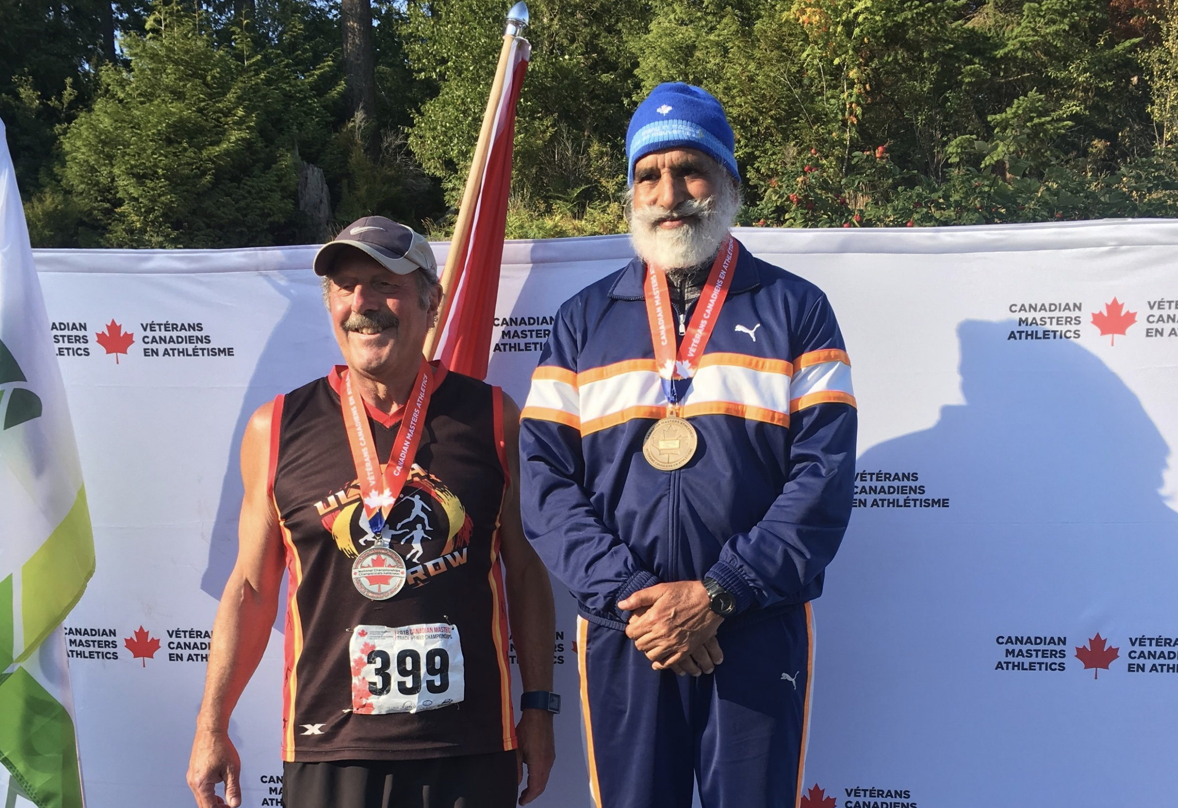 Dave Uliis and Harnek Toor medal in the hammer.