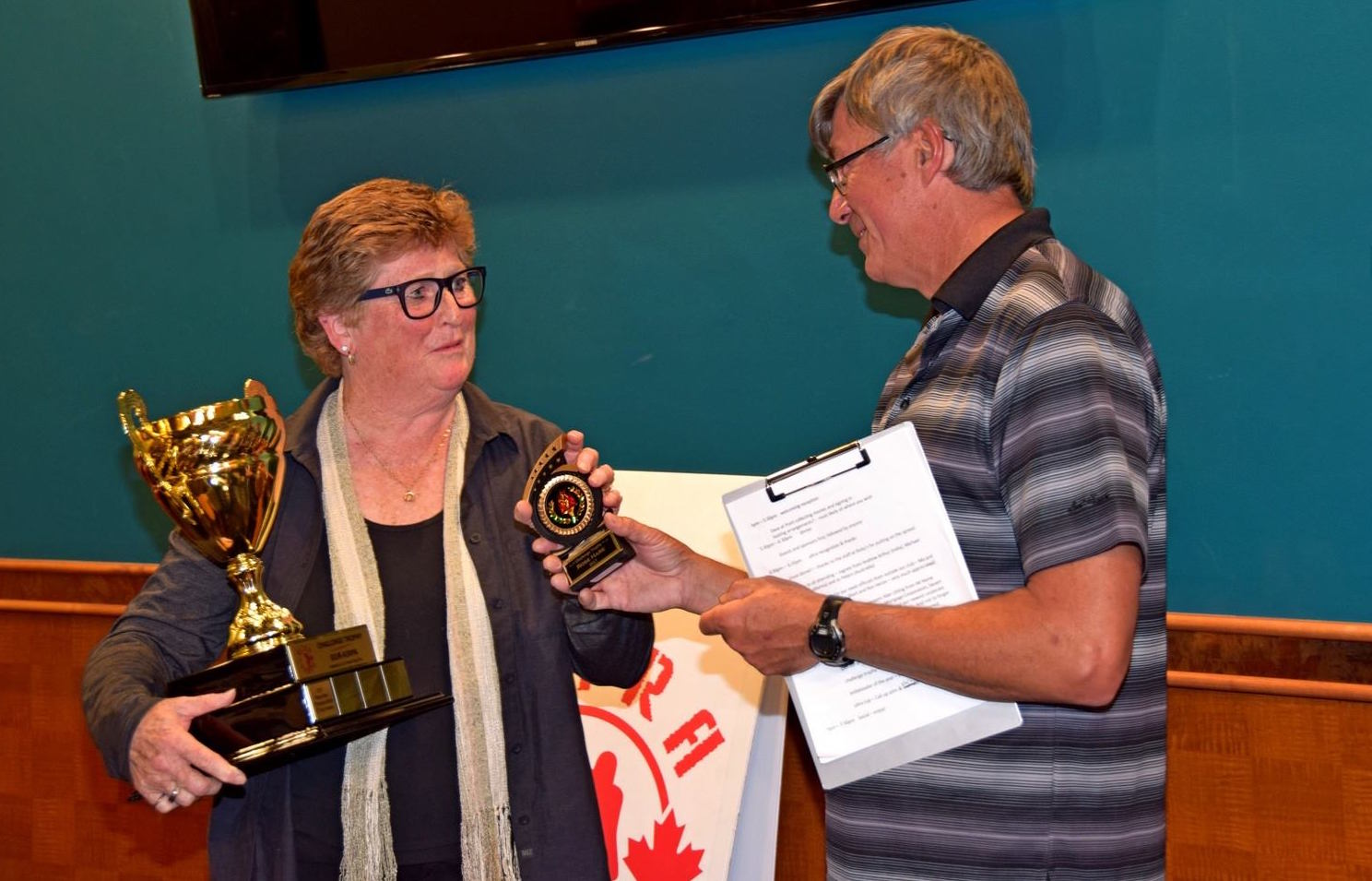 Rose taking two trophies from Ultra Throw in 2017, presented by club president, Dave McDonald.