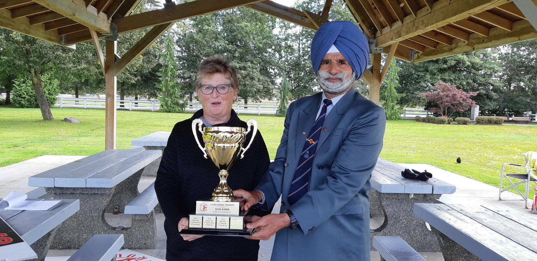 Rose Hare is presented the Challenge Trophy by Harnek Toor on Sept. 28 at McLeod Athletic Park, Surrey, BC.