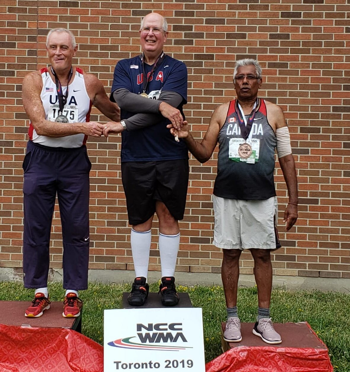 Ultra Throw's Mohan Bains seen far left in Toronto with  proud winners of 65-69 age group in the Hammer Throw