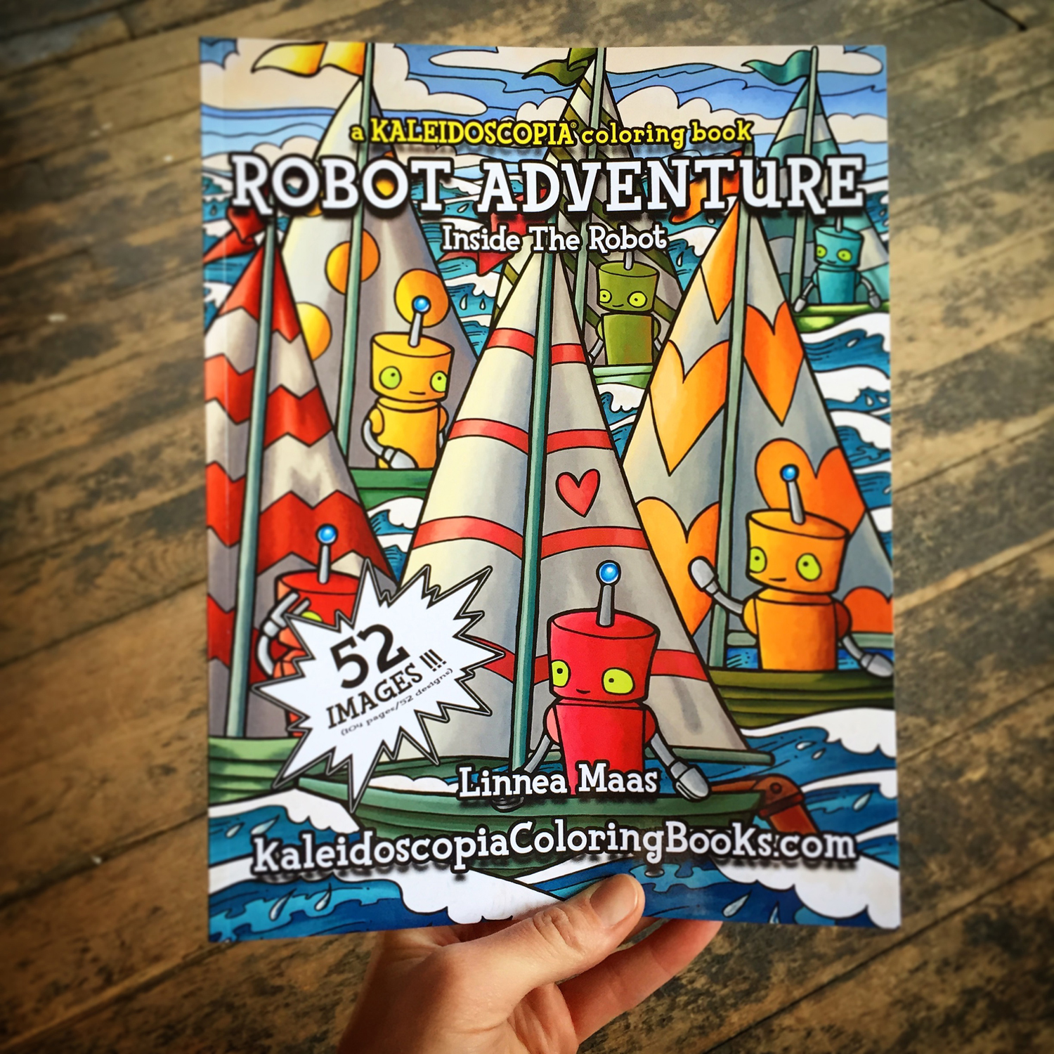 Hand holding a copy of Robot Adventure: Inside The Robot colorin